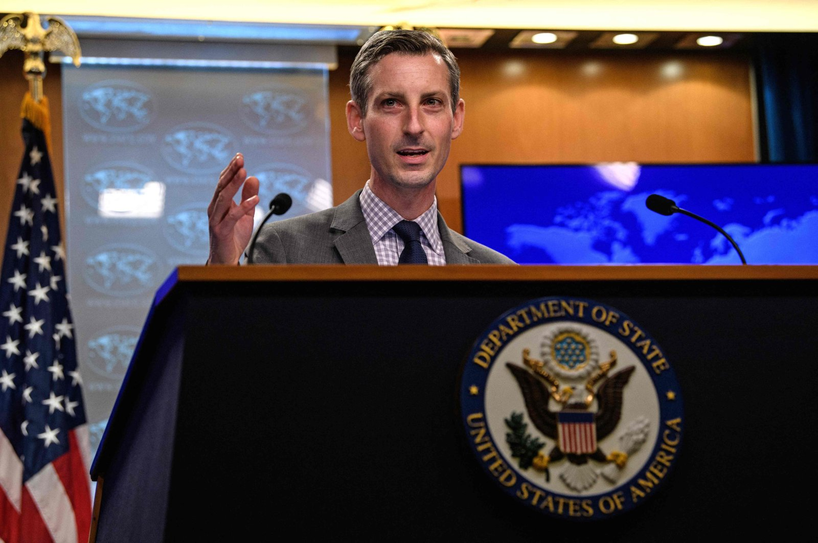 US State Department spokesman Ned Price gestures as he speaks during the daily press briefing at the State Department in Washington, DC, on February 25, 2021. (AFP Photo)