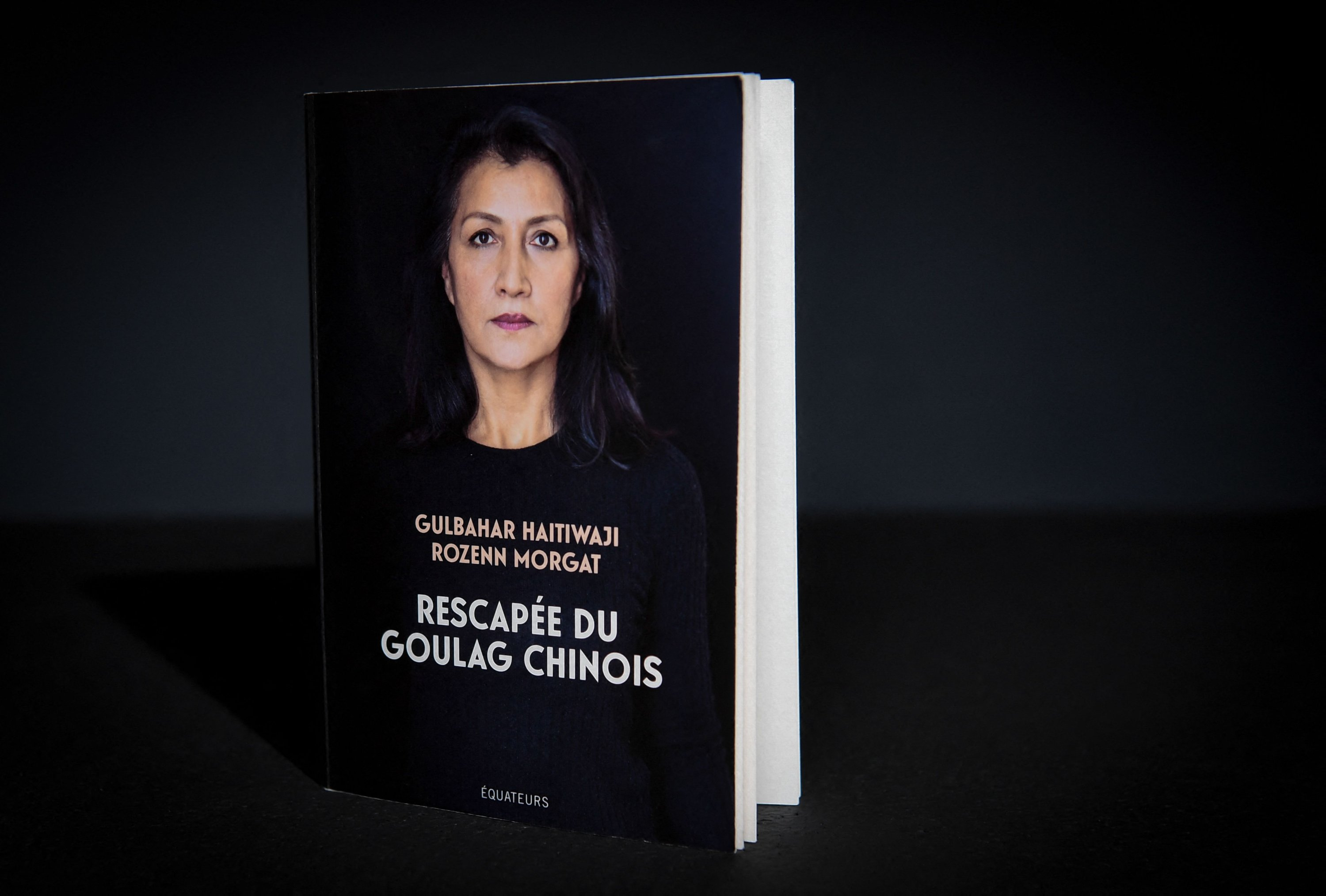 """The book """"Rescapee du Goulag Chinois"""" (Survivor of the Chinese Gulag), written by Gulbahar Haitiwaji, co-authored with Le Figaro journalist Rozenn Morgat and published by Editions des Equateurs can be seen, Paris, March 1, 2021. (AFP Photo)"""