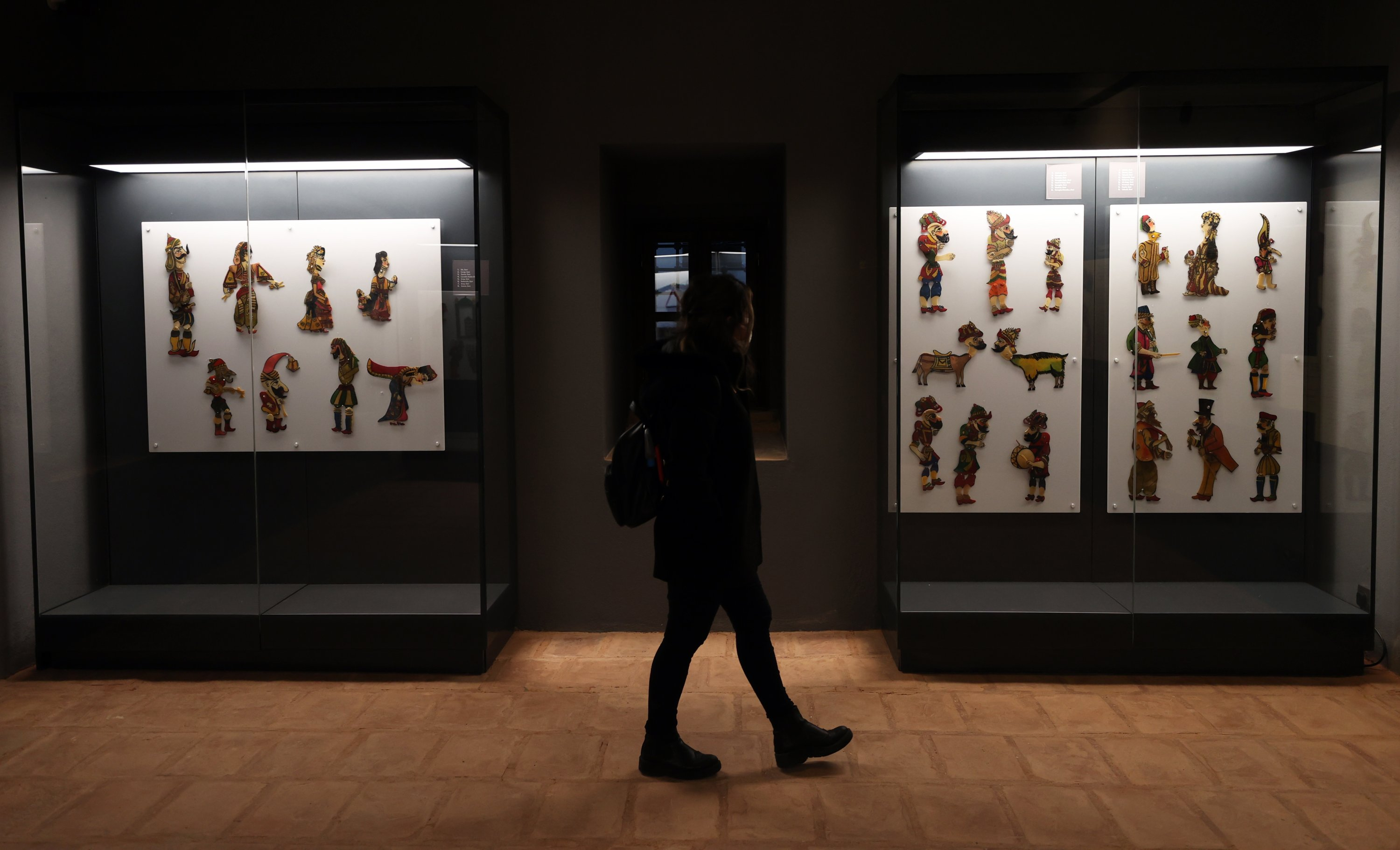 A visitor passes by Karagöz-Hacivat figures at the Museum of Turkish Islamic Arts, Bursa, northwestern Turkey, Feb. 26, 2021. (AA PHOTO)