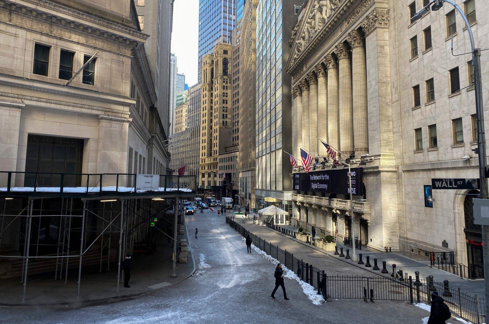 People walk on Wall Street in New York, U.S., Feb. 8, 2021. (AFP Photo)
