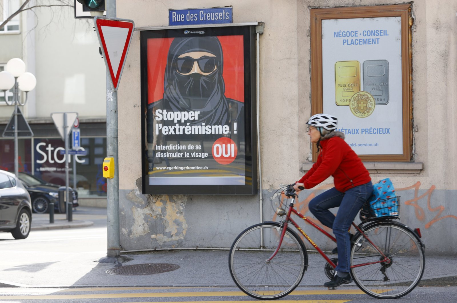 """A poster reads """"Stop Extremism!"""" ahead of a Swiss vote on banning face veils in a referendum in Sion, Switzerland, Feb. 26, 2021. (Reuters Photo)"""