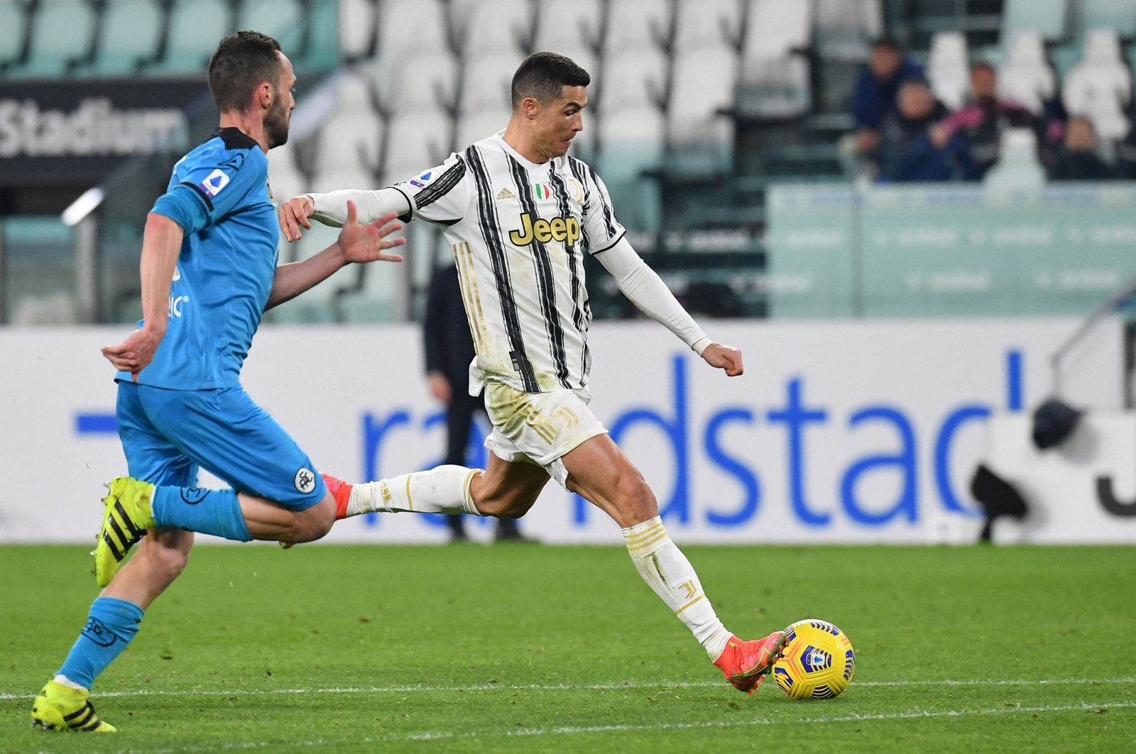 Juventus' Portuguese forward Cristiano Ronaldo prepares to shoot and score his side's third goal against Spezia at the Juventus stadium in Turin, Italy, March 02, 2021. (AFP Photo)