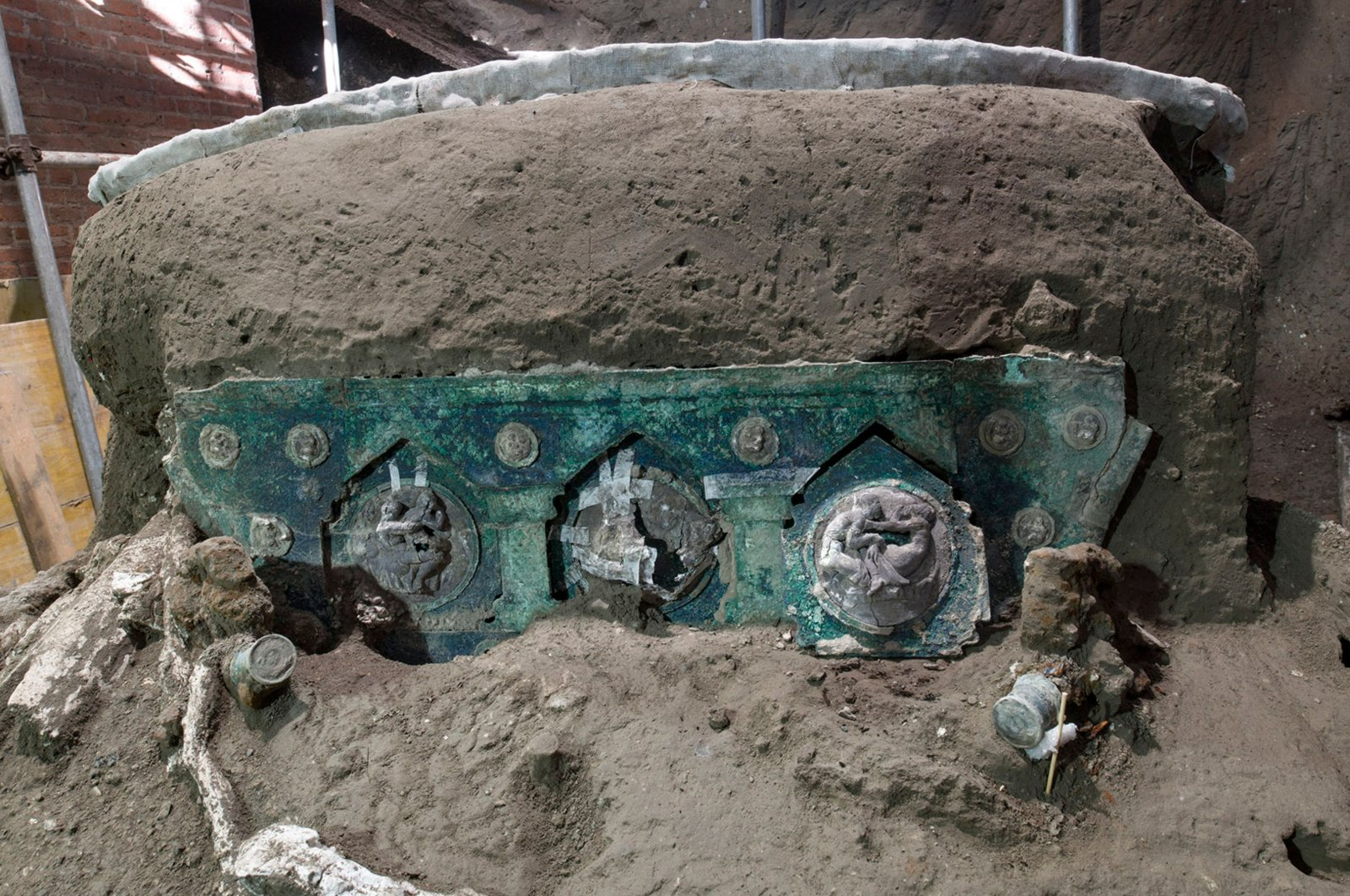 A photo handout on Feb. 27, 2021 by the archaeological park of Pompeii shows a detail of a large Roman four-wheeled ceremonial chariot after it was discovered near the archaeological park of Pompeii. (AFP Photo)