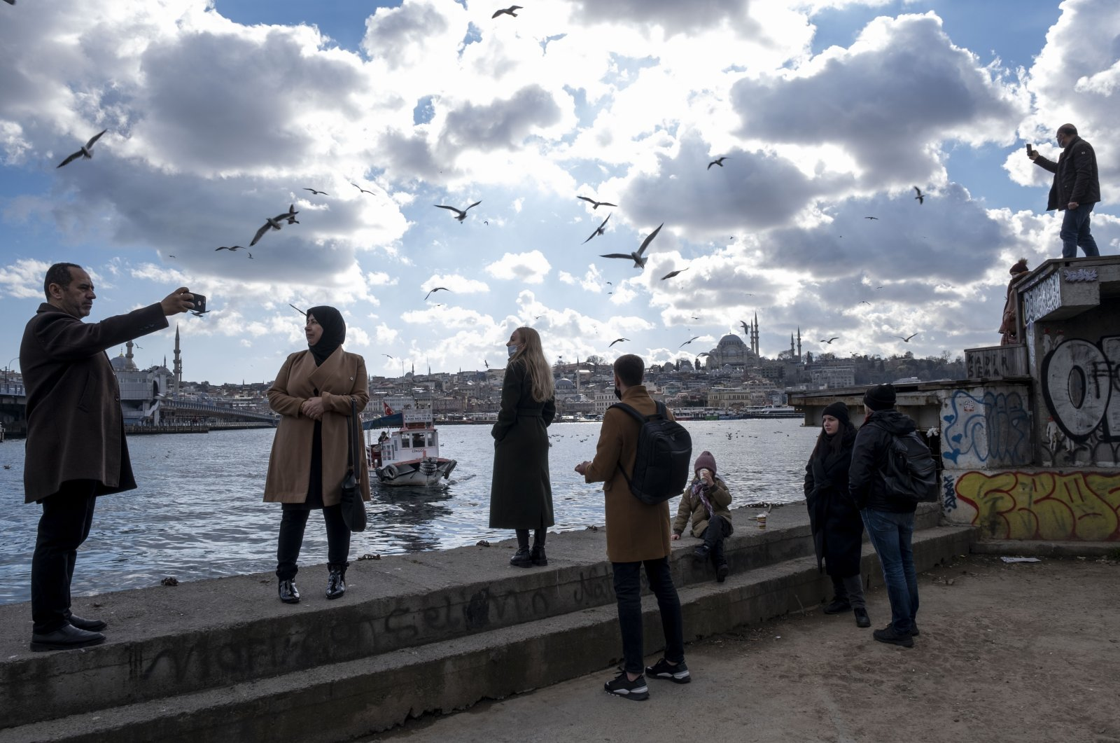People spending time at the Karaköy seaside amid the pandemic, Istanbul, Turkey, Feb. 28, 2021. (Photo by Getty Images)