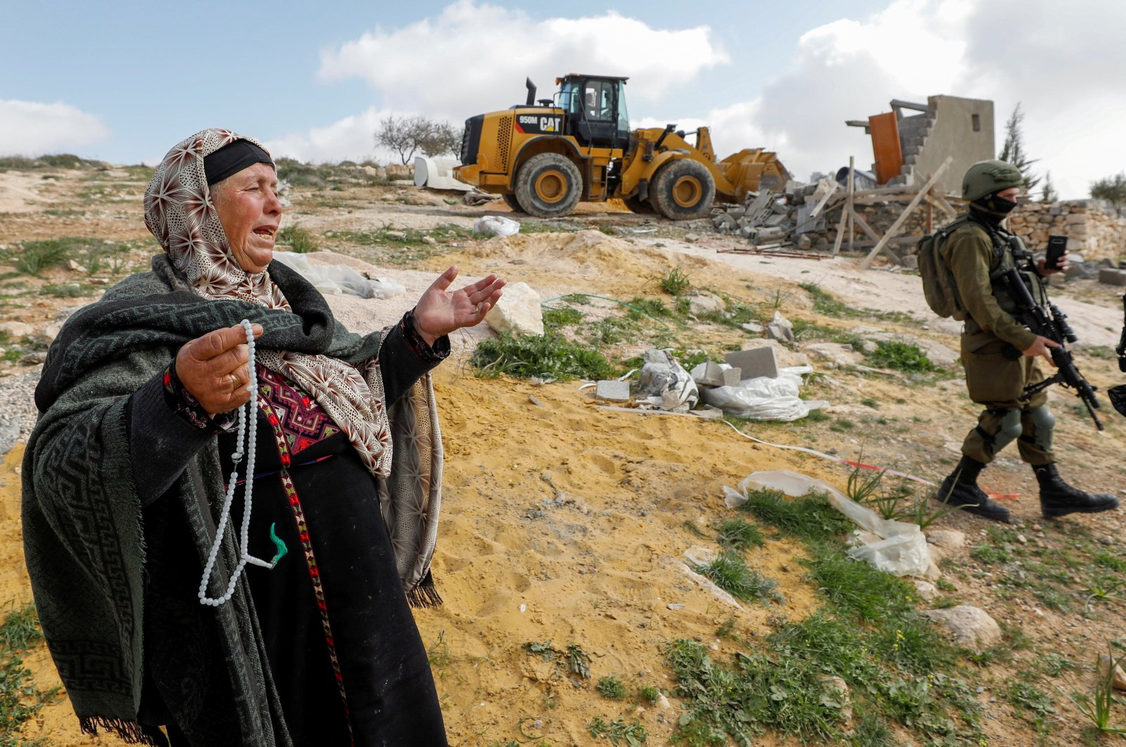 A Palestinian woman reacts as Israeli forces demolish her house near Hebron in the Israeli-occupied West Bank, March 2, 2021. (Reuters Photo)