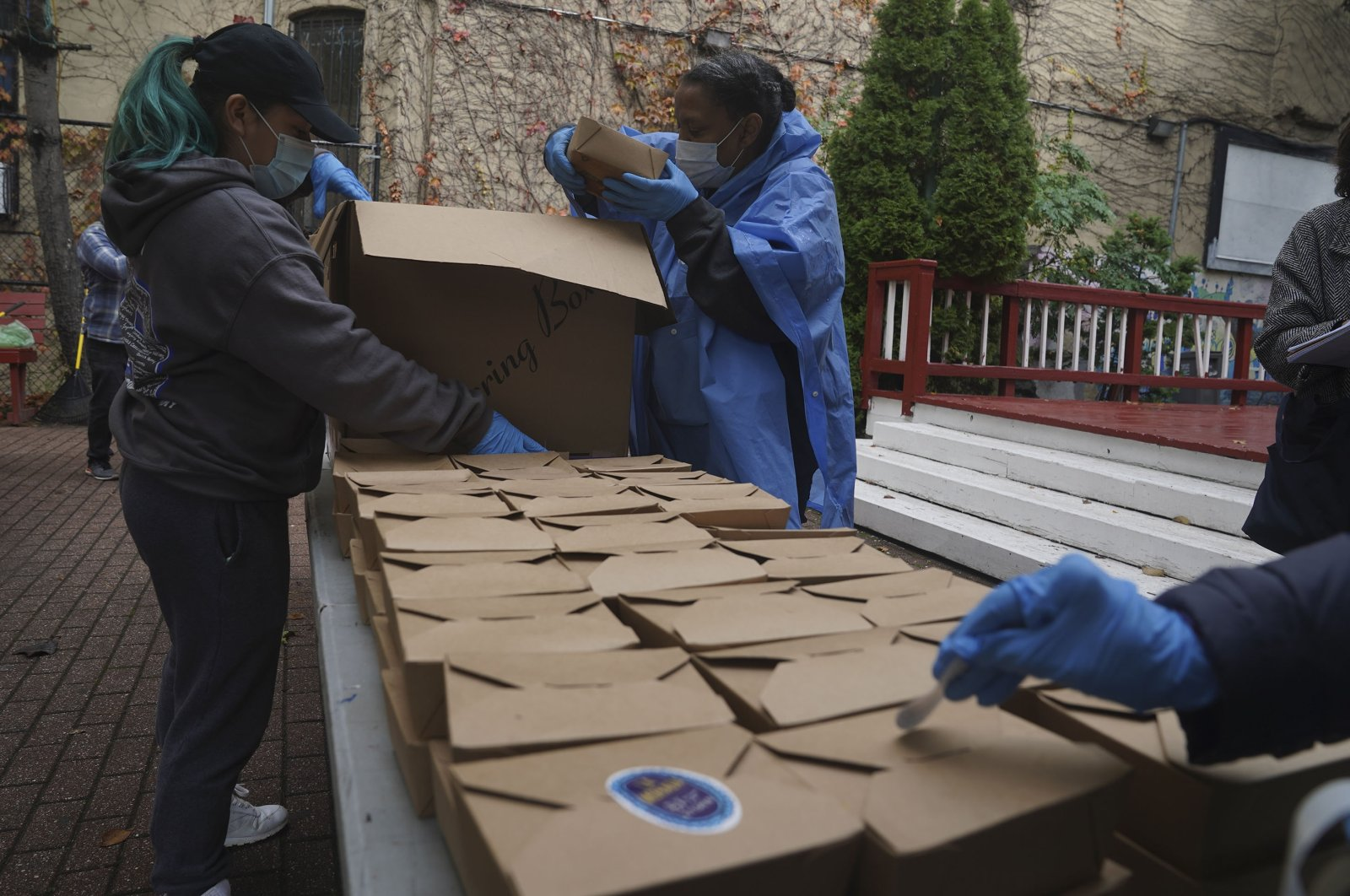 Volunteers unload boxed meals prepared at the South Bronx restaurant La Morada, in New York City, New York, U.S., Oct. 28, 2020. (AP Photo)
