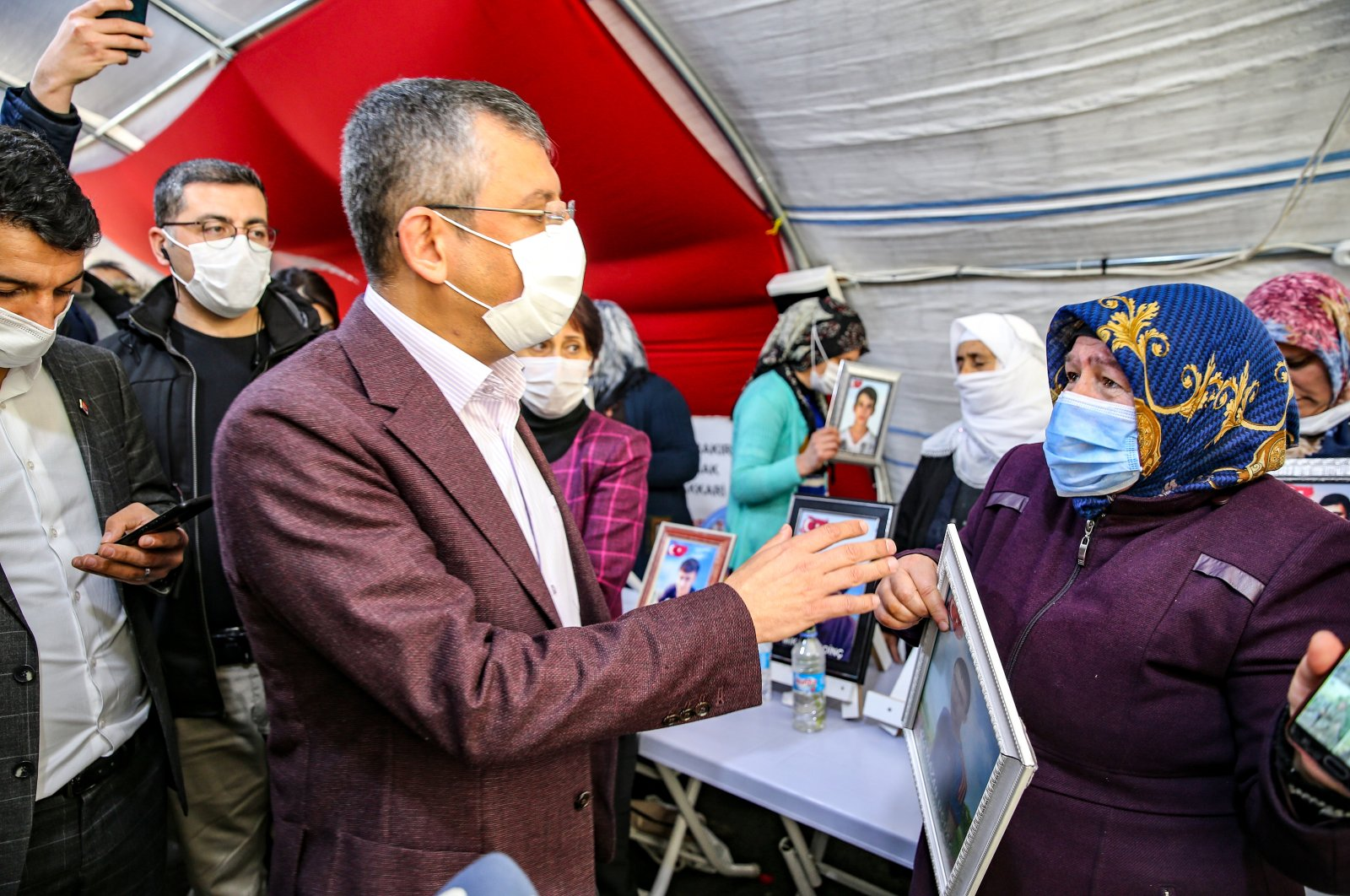 CHP Group Deputy Chairperson Özgür Özel speaks with a mother protesting her son's abduction by the PKK terrorists in front of the pro-PKK HDP headquarters in Diyarbakır on March 3, 2021 (AA Photo)