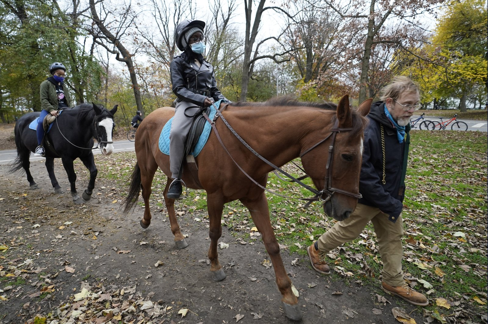 Kensington Stables trail guide Bill Zimmerman leads horseback riders along a bridle path through Prospect Park, Sunday, Nov. 15, 2020, in the Brooklyn borough of New York. (AP File Photo)