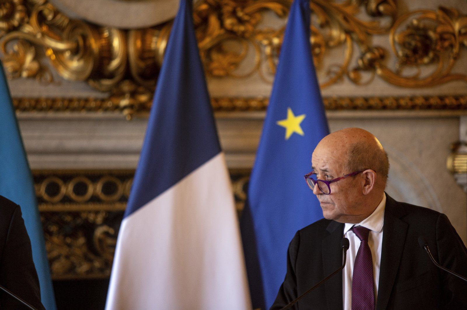 French Foreign Affairs Minister Jean-Yves Le Drian attends a news conference with his Ukrainian counterpart Dmytro Kuleba, at the Quai d'Orsay, in Paris, France, Friday, Feb. 26, 2021. (AP Photo)