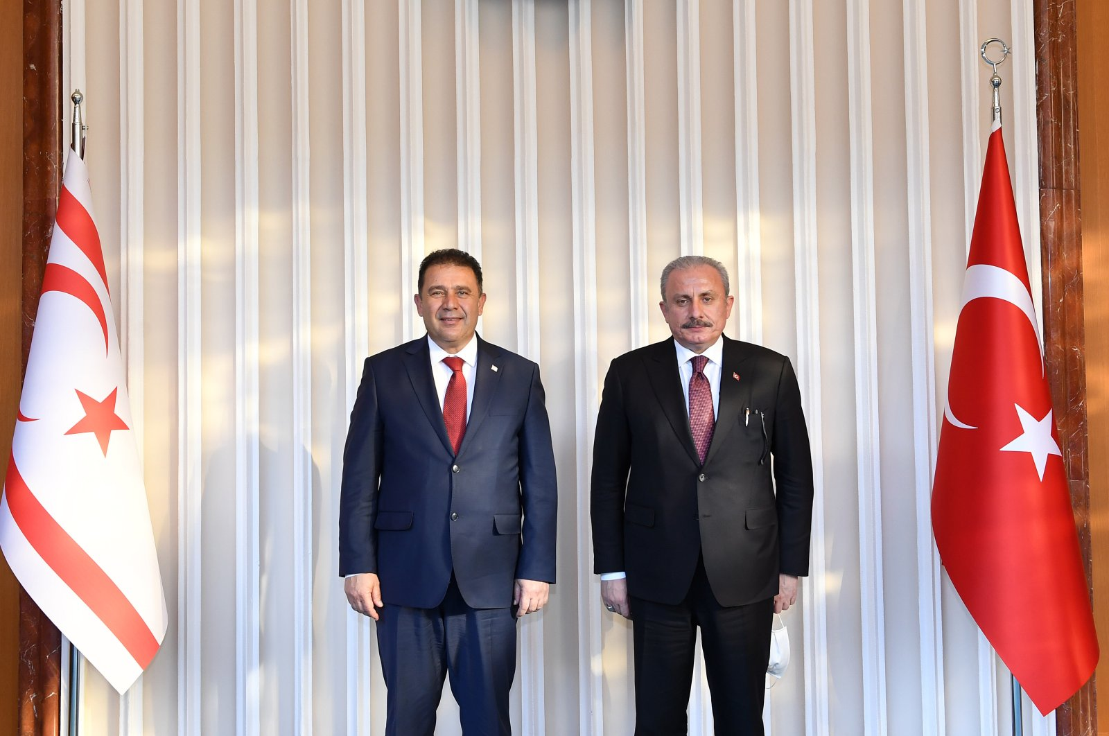 Turkish Republic of Northern Cyprus (TRNC) Prime Minister Ersan Saner (L) and Turkey's Parliament Speaker Mustafa Şentop pose for a photo before a meeting in the capital Ankara, Turkey, March 3, 2021. (AA Photo)