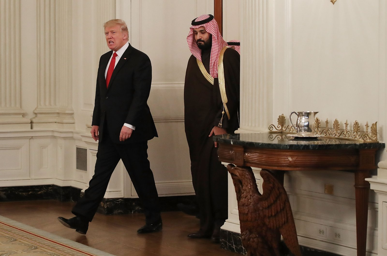 Then-U.S. President Donald Trump (L) and Saudi Crown Prince Mohammed bin Salman walk at the White House, Washington, D.C., U.S., March 14, 2017. (Photo by Getty Images)