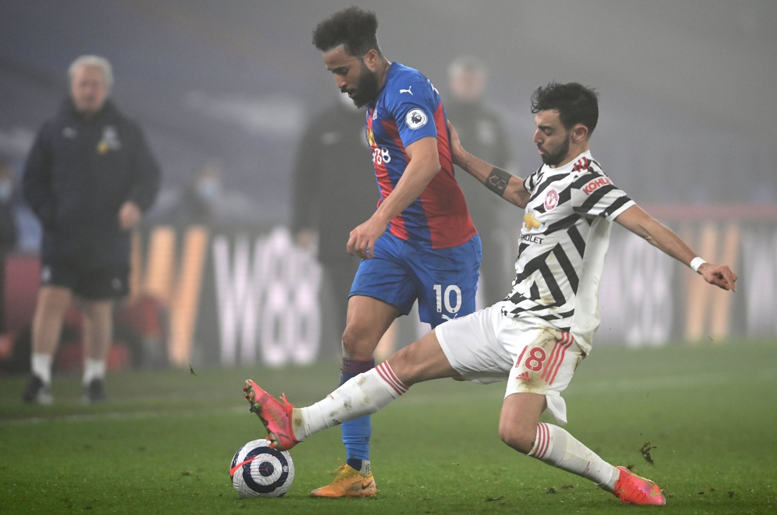Manchester United's Bruno Fernandes (R) in action against Crystal Palace's Andros Townsend (L) during the English Premier League match in London, Britain, March 3, 2021. (EPA Photo)