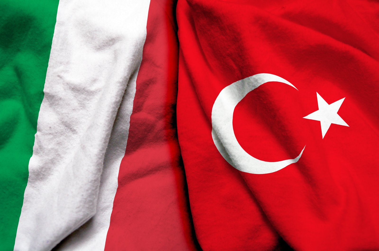 The flags of Turkey and Italy are pictured side by side in this illustration. (Photo by Shutterstock)