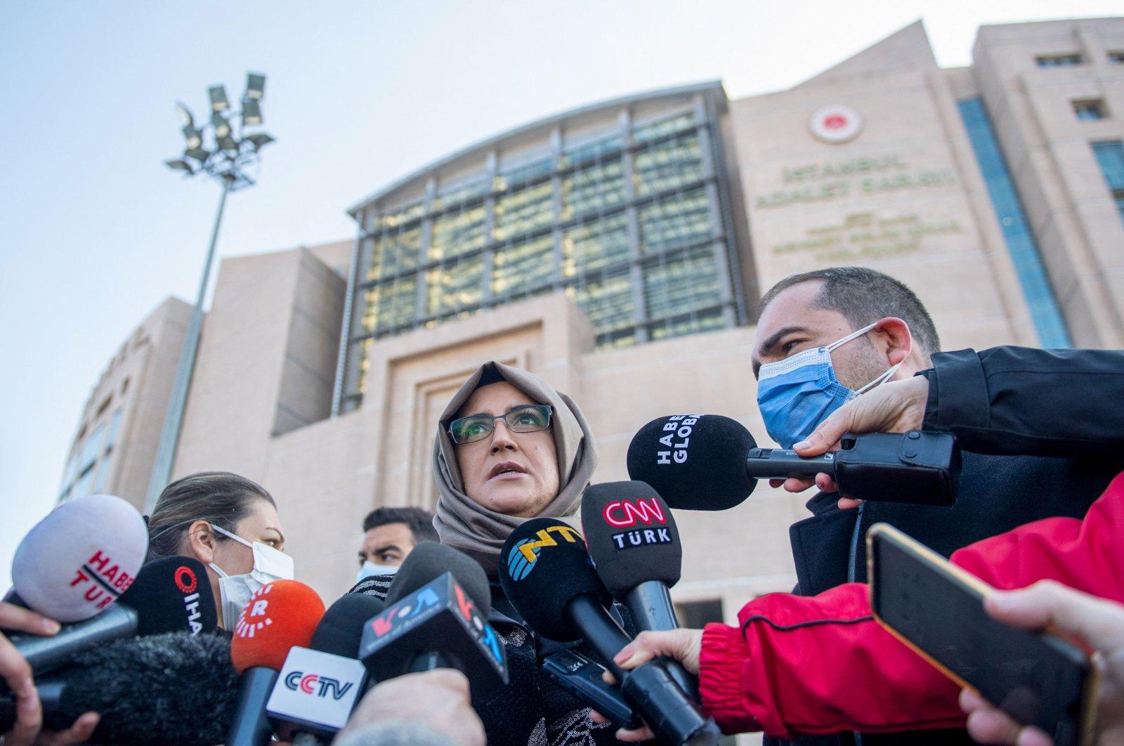 Hatice Cengiz (C) fiancee of slain Saudi dissident journalist Jamal Khashoggi, talks to the press in front of the Istanbul courthouse, Turkey, March 4, 2021. (AFP Photo)