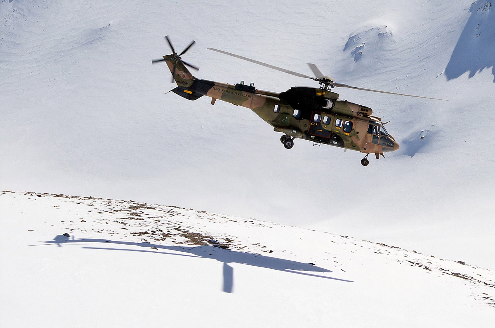 An undated photo of the Cougar helicopter, the same model that crashed in Turkey's Bitlis on March 4, flying through a mountainous area. (Photo courtesy of Turkish Armed Forces)