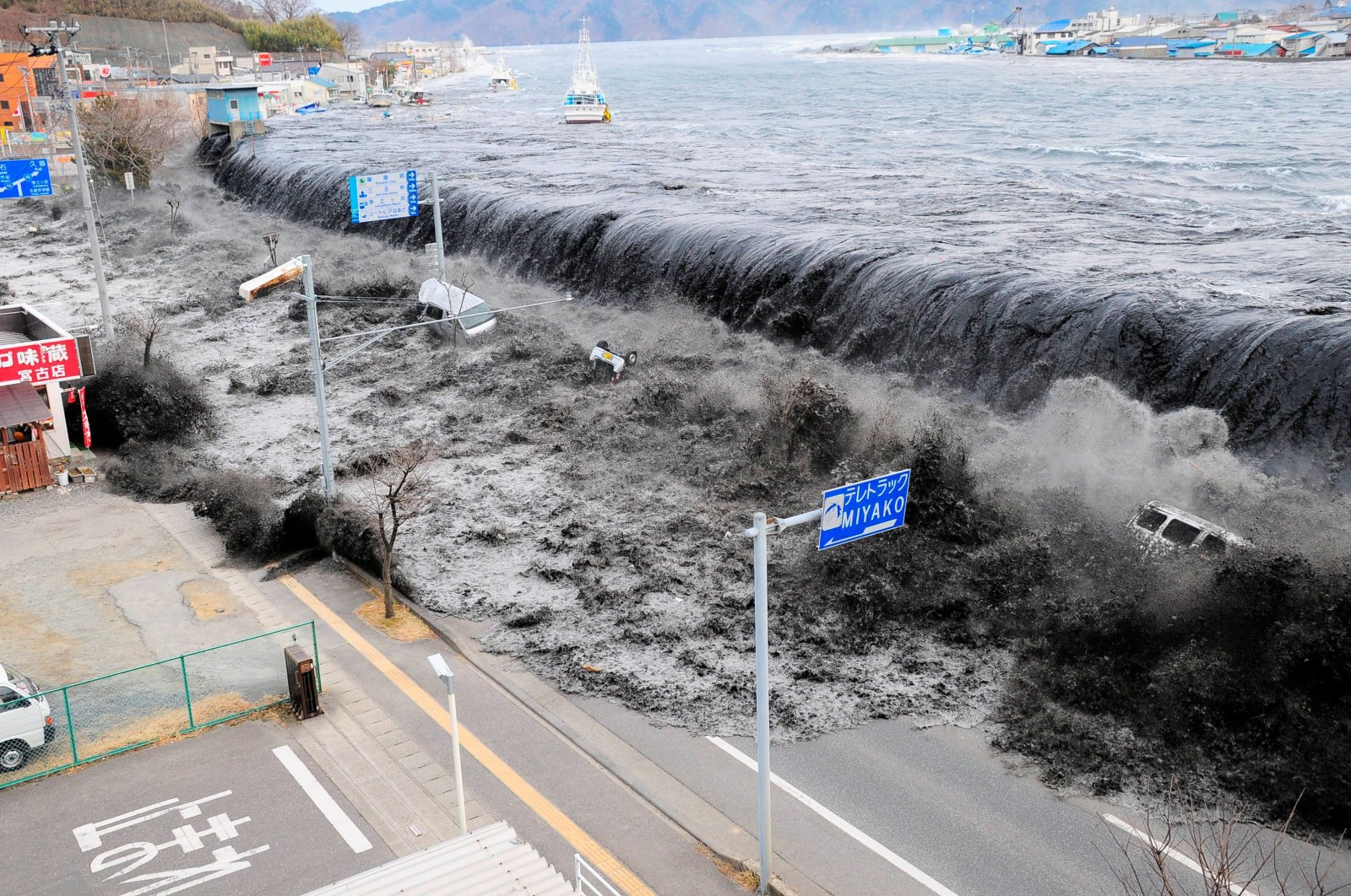 In this file photo a wave approaches Miyako City from the Heigawa estuary in Iwate Prefecture after the 8.9 magnitude earthquake struck the area on March 11, 2011. (Reuters)