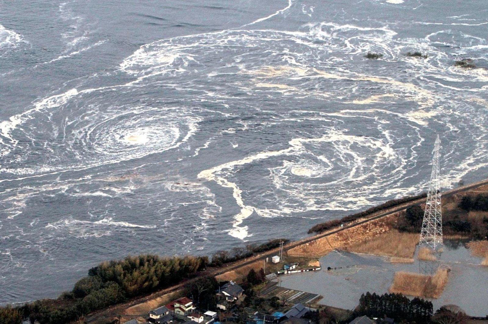 Whirlpools are seen following a tsunami and earthquake in Iwaki, Fukushima Prefecture, Japan, March 11, 2011. (Reuters File Photo)