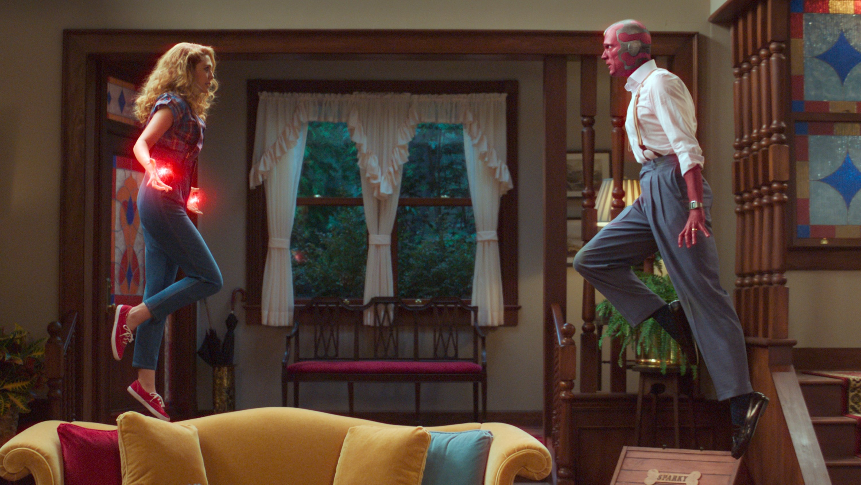 This image released by Disney  shows Elizabeth Olsen (L)and Paul Bettany in a scene from 'WandaVision.' (AP Photo)