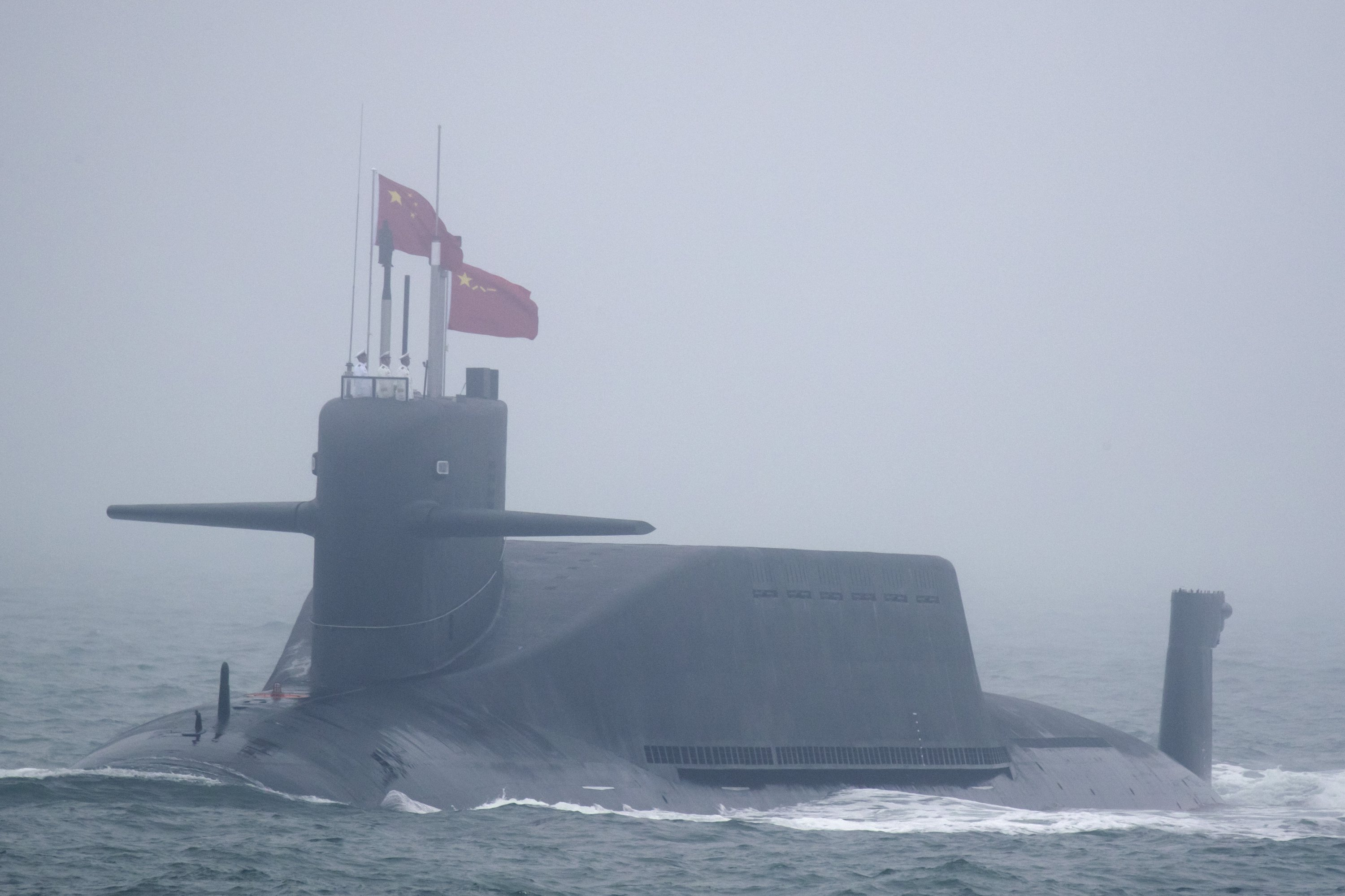 A type 094A Jin-class nuclear submarine of the Chinese navy participates in a naval parade in the sea near Qingdao, Shandong province, eastern China, April 23, 2019. (AP Photo)