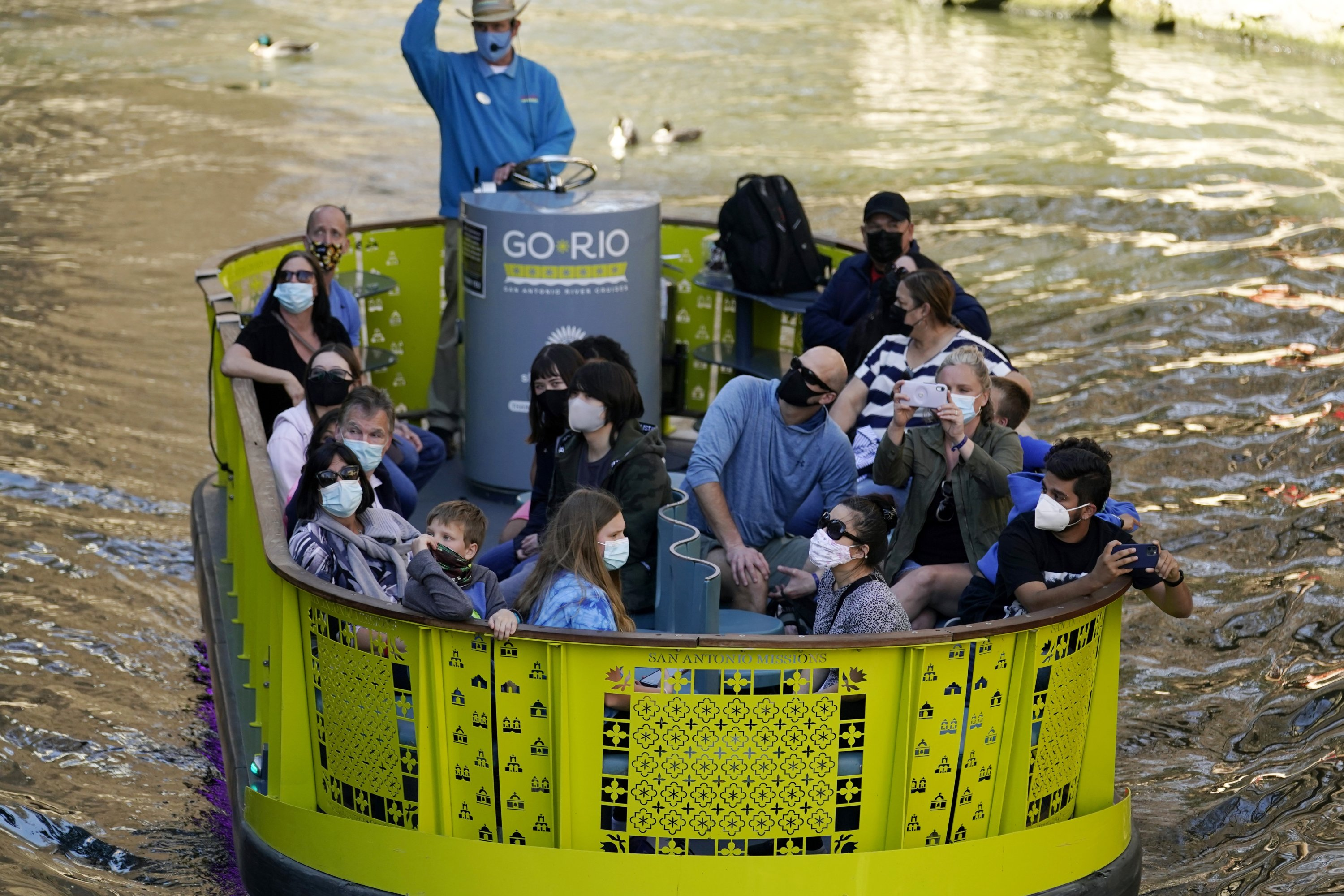 Visitors wear face masks during the coronavirus pandemic as they travel along the River Walk in San Antonio, Texas, March 3, 2021. (AP Photo/Eric Gay)