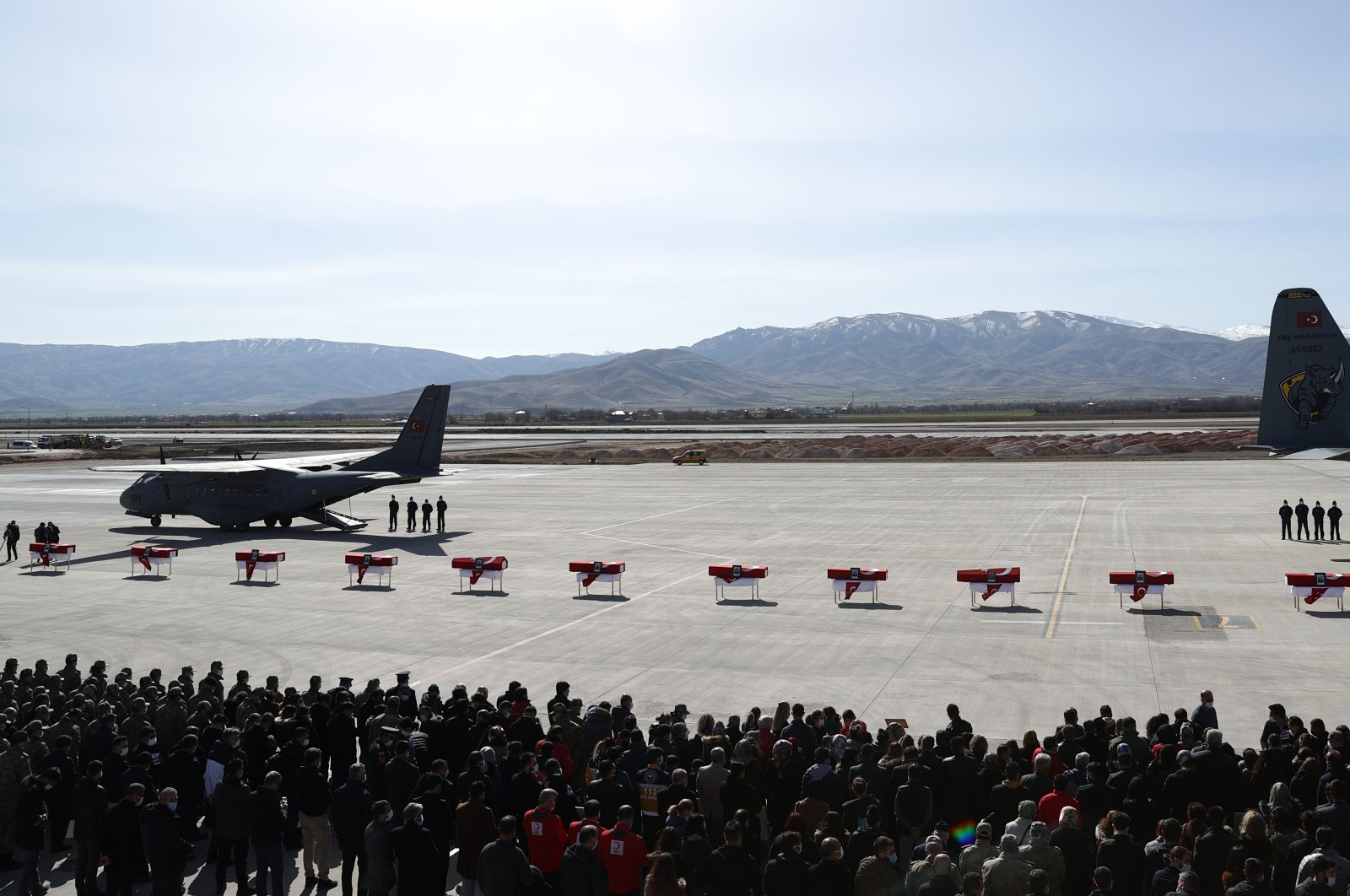 A view of coffins lined on the runway during a military funeral service in Elazığ, eastern Turkey, March 5, 2021. (AA PHOTO)
