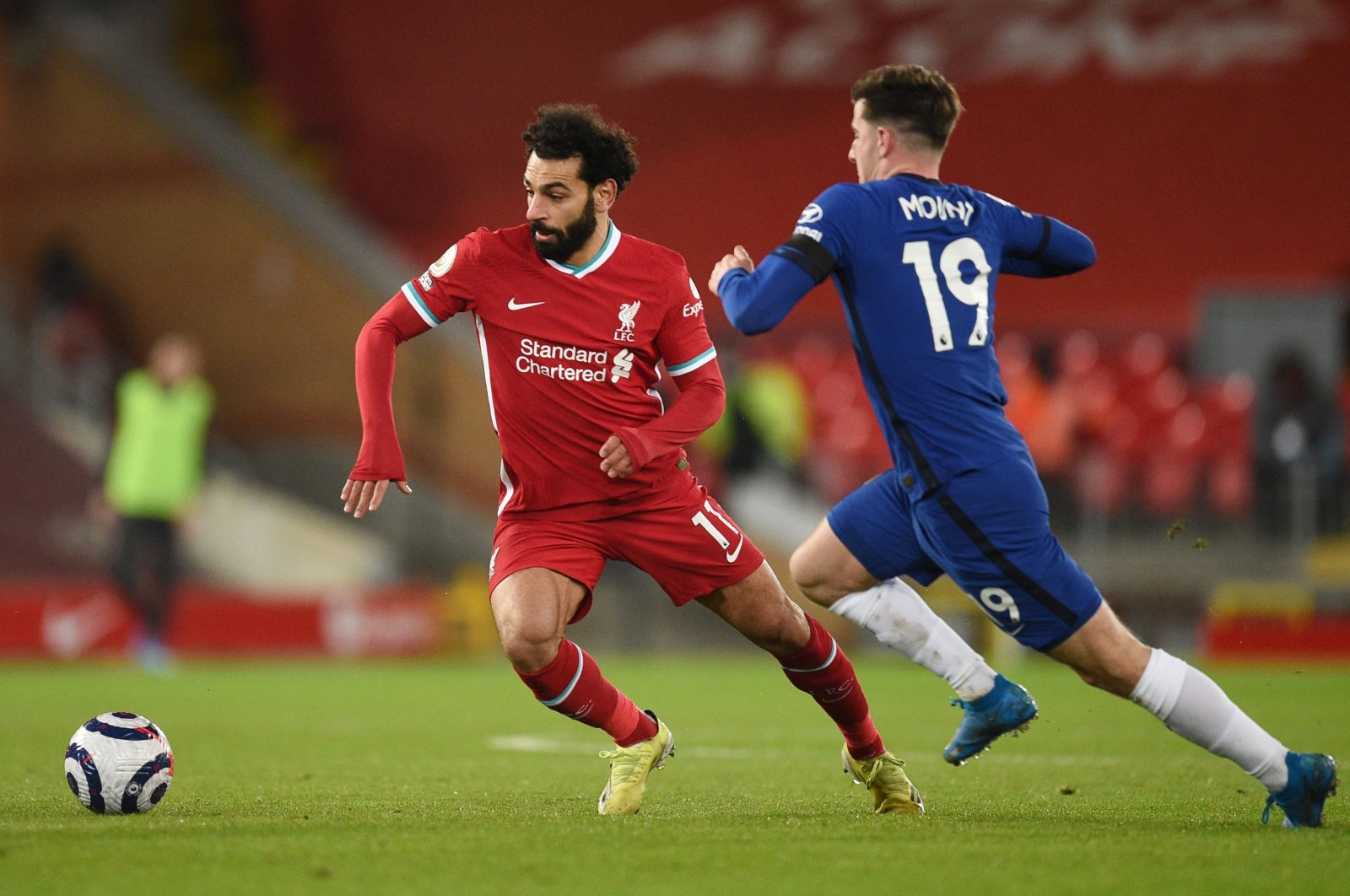 Liverpool's Mohamed Salah (L) in action with Chelsea's Mason Mount during a Premier League match at Anfield, Liverpool, Britain, March 4, 2021. (Reuters Photo)