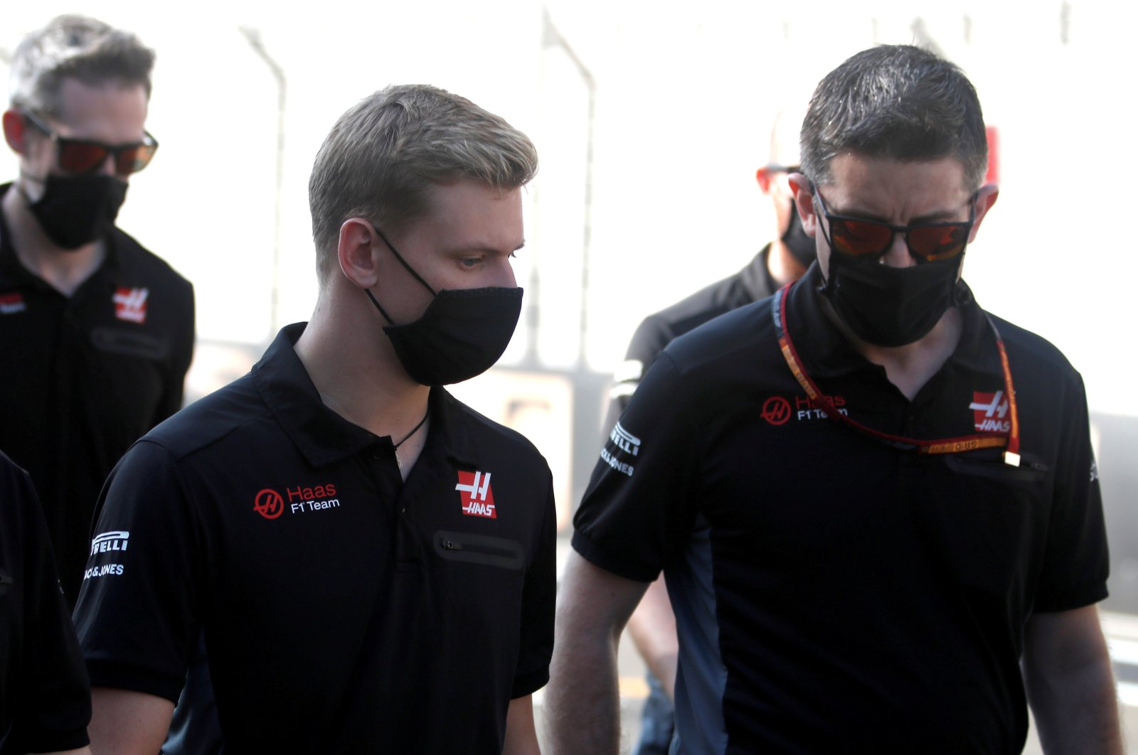 Haas' Mick Schumacher (L) walks the circuit with his team at Yas Marina Circuit, Abu Dhabi, United Arab Emirates,Dec. 10, 2020. (Reuters Photo)