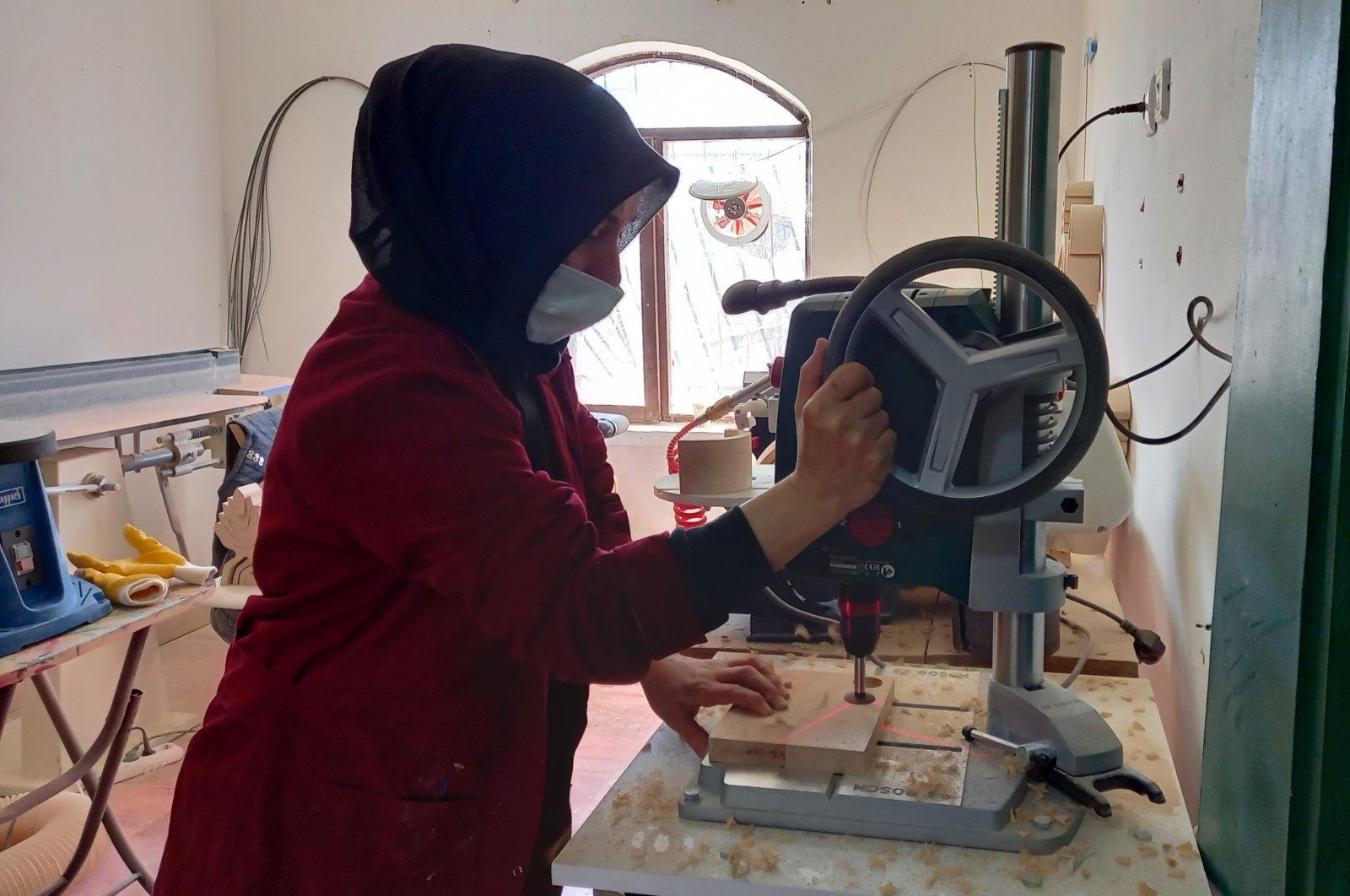 Emine Şimşek, an entrepreneur, works in her workshop where she produces and exports wooden toys, in Kırıkkale, central Turkey, Feb. 28, 2021. (IHA PHOTO)