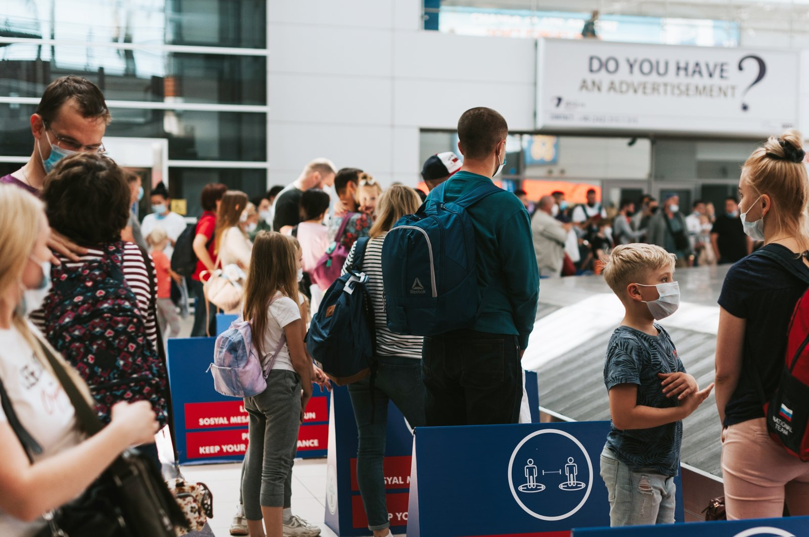 People wait for luggage claim at the Antalya International Airport, Antalya, southern Turkey, August 2020. (Shutterstock Photo)