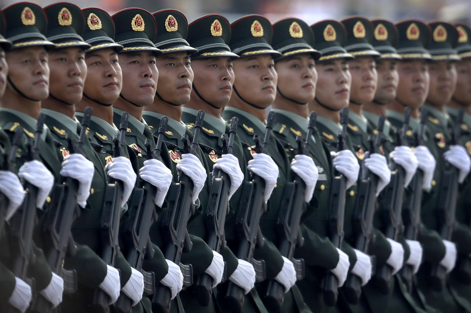 Chinese People's Liberation Army (PLA) soldiers march in formation during a parade to commemorate the 70th anniversary of the founding of the People's Republic of China in Beijing, China, Oct. 1, 2019. (AP Photo)