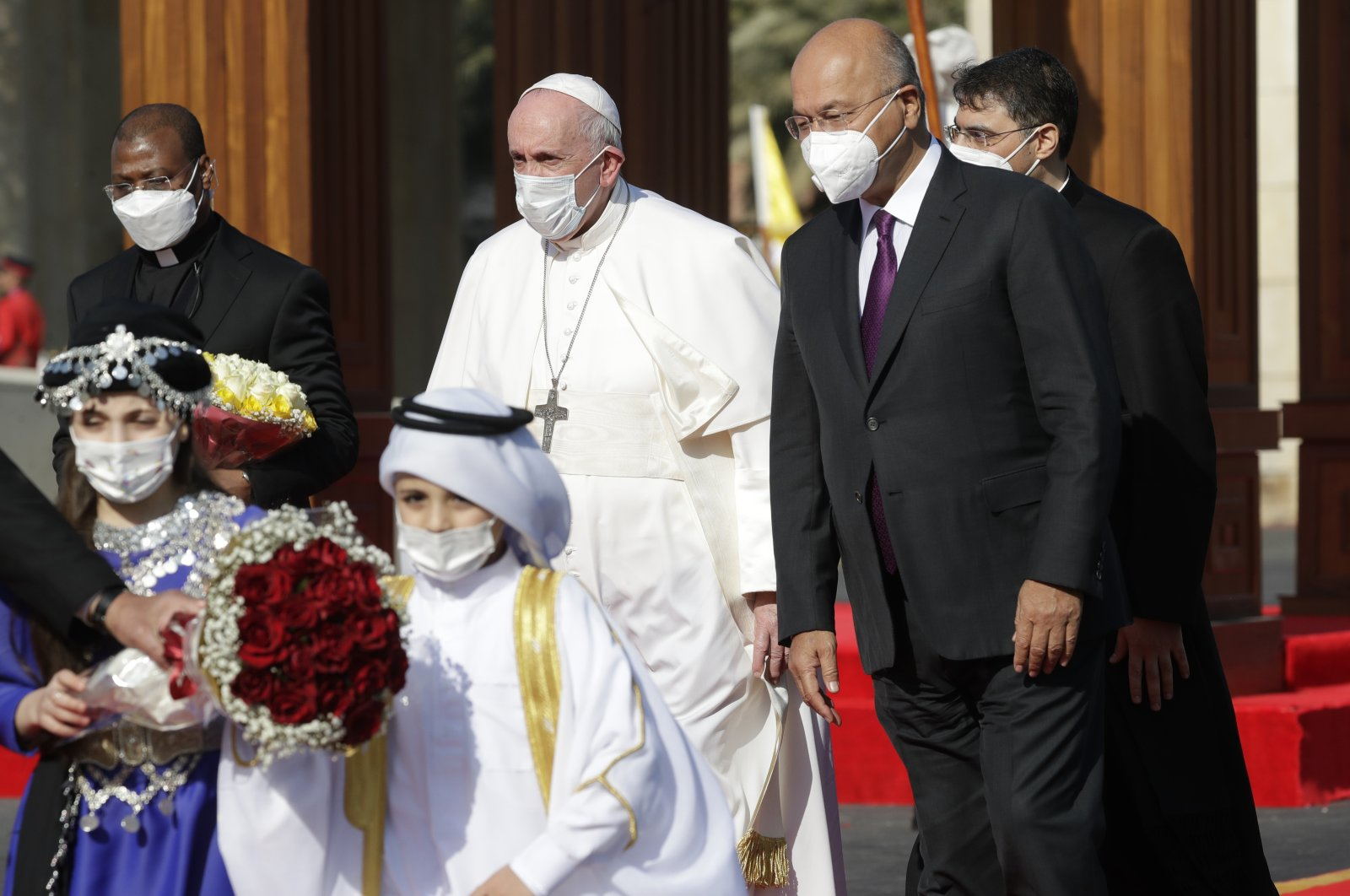 Pope Francis is welcomed by Iraqi President Barham Salih, at Baghdad's Presidential Palace, Iraq, Friday, March 5, 2021. (AP Photo)