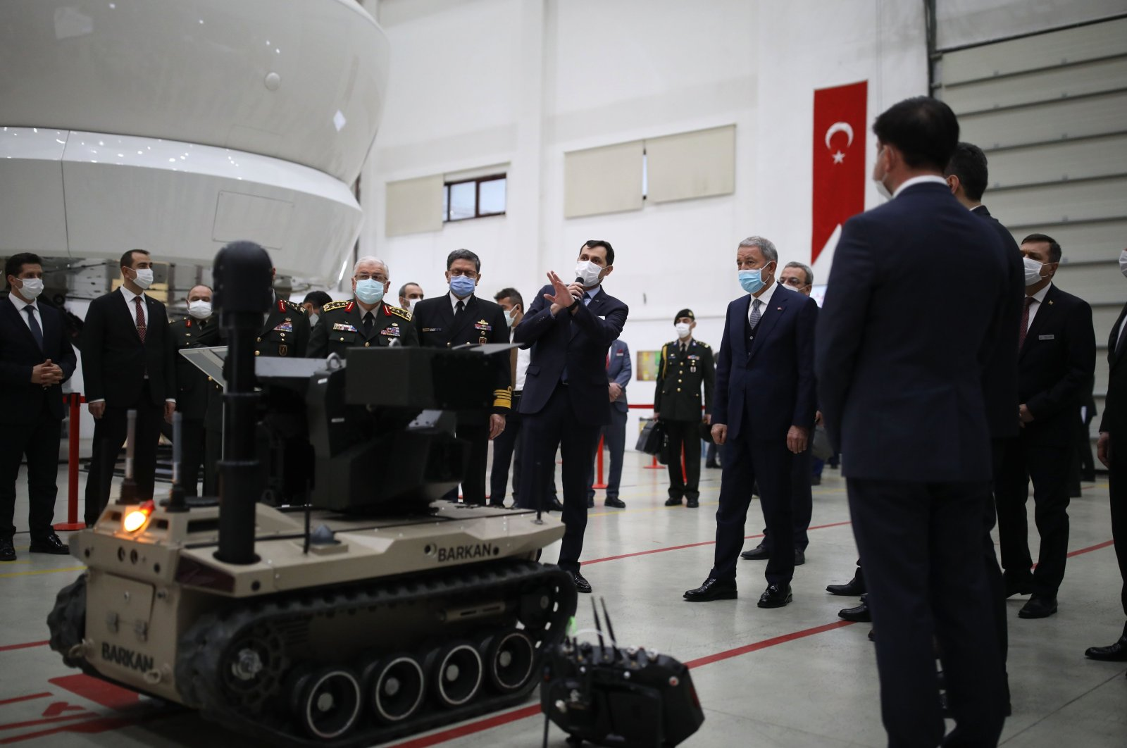 National Defense Minister Hulusi Akar examines products, including an unmanned ground vehicle (UGV) during a visit to Havelsan, Ankara, Turkey, Feb. 27, 2021. (DHA Photo)