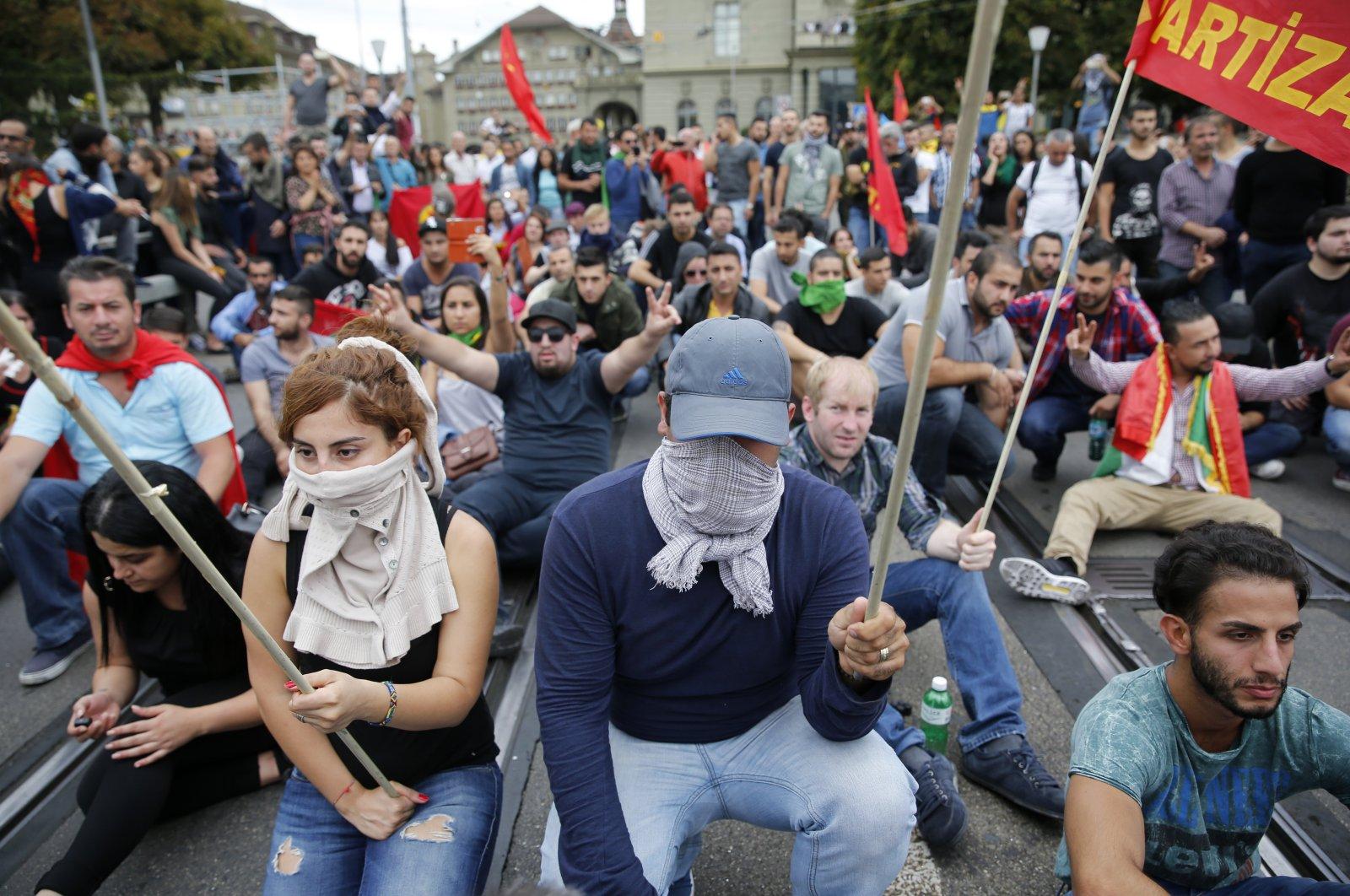 Protesters in Switzerland stage a demonstration on the Kirchenfeld bridge, Bern, Switzerland, Sept. 12, 2015. (AP Photo)