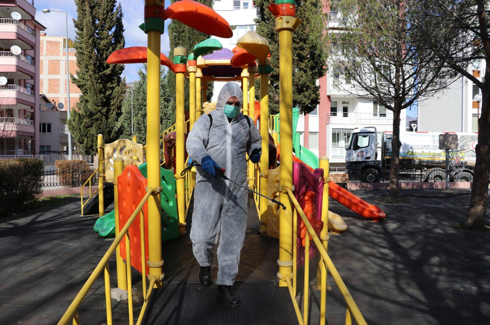 An Amasya Municipality worker disinfects a children's park in Amasya, northern Turkey, March 5, 2021. (AA Photo)