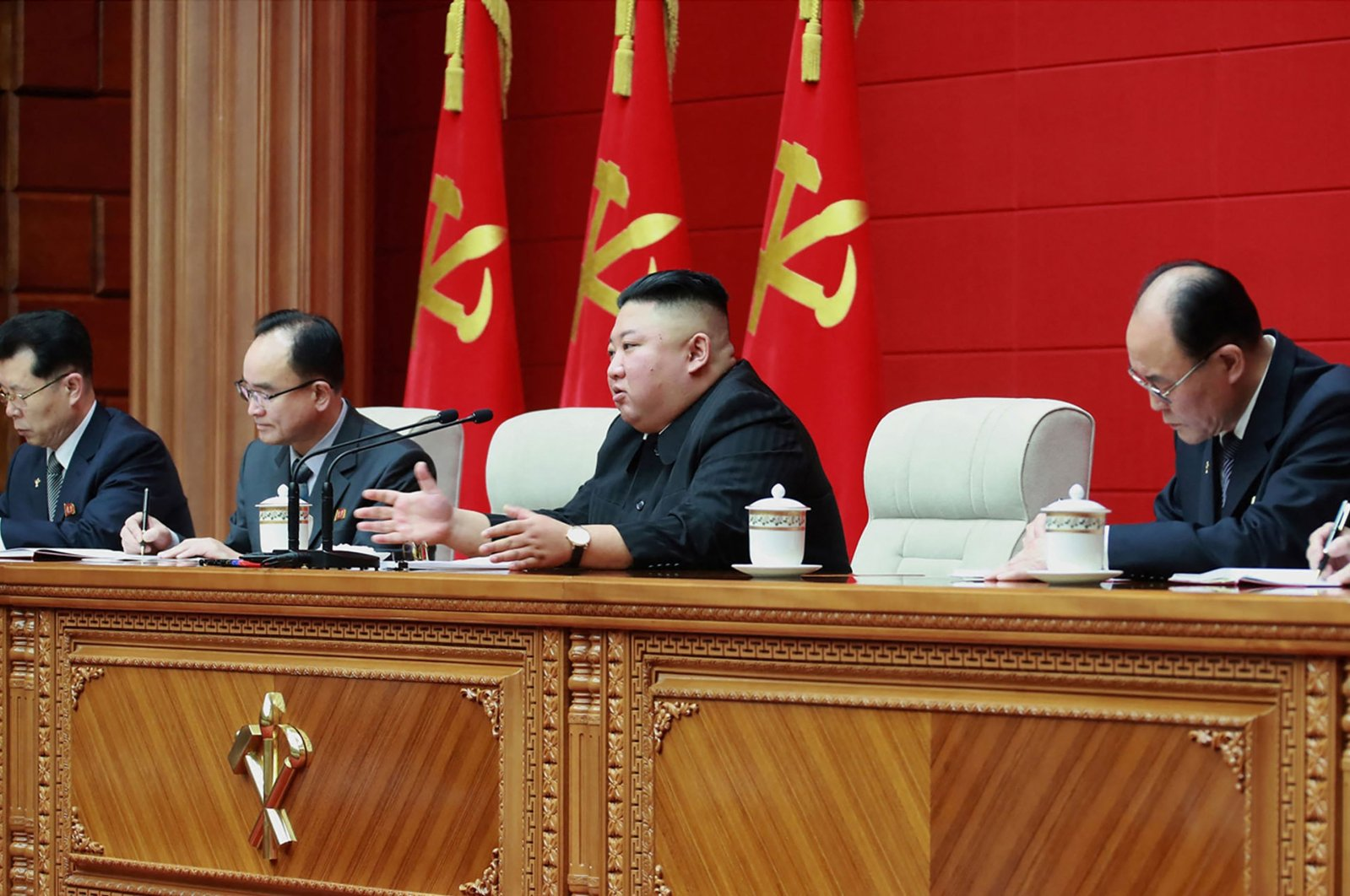 North Korean leader Kim Jong Un (2nd R) speaks during the second day sitting of the first short course for chief secretaries of city and county party committees in Pyongyang, March 4, 2021. (KCNA Photo via KNS/AFP)