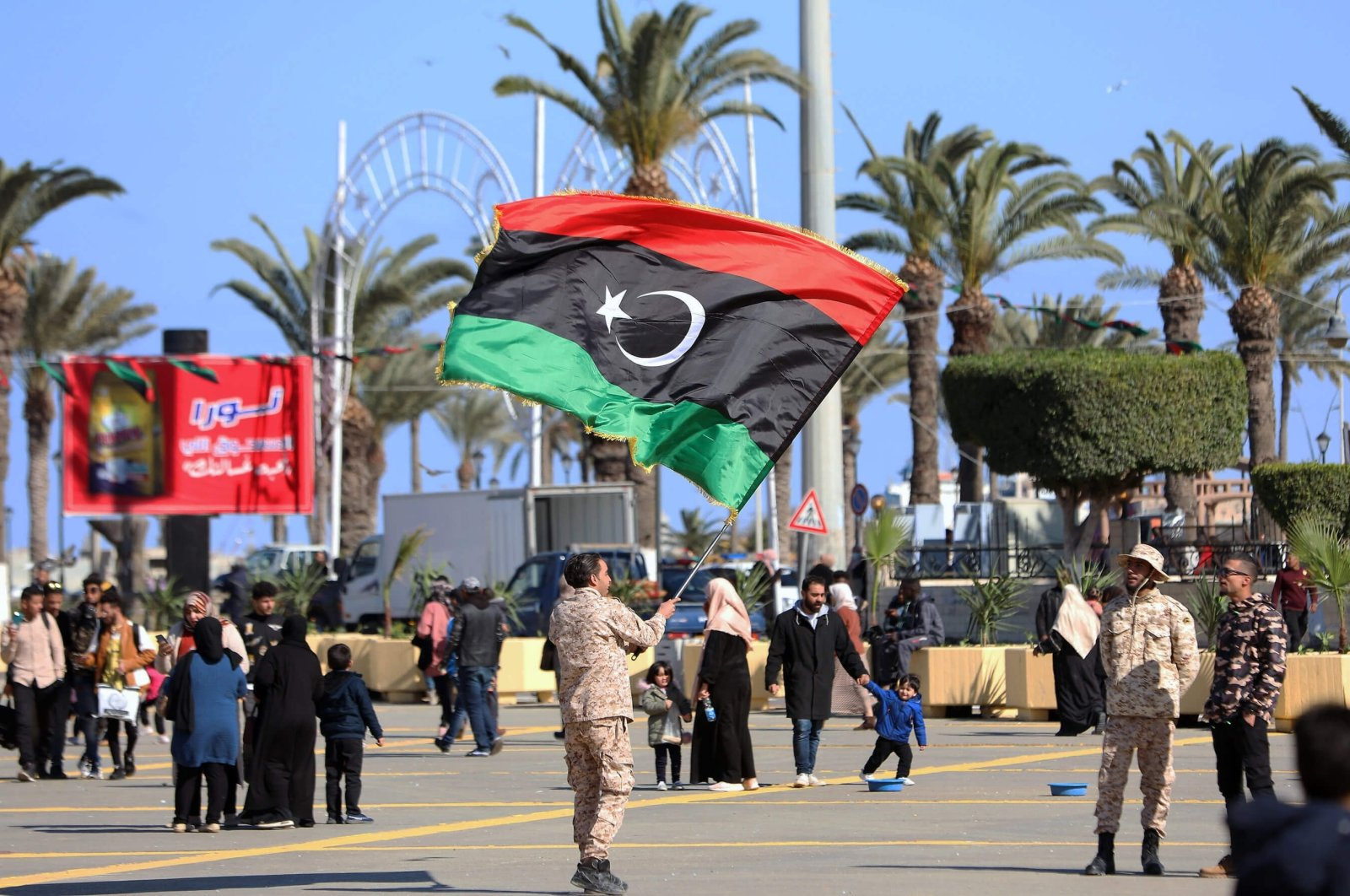 A soldier waves the Libyan flag a day ahead of the 10th anniversary of the country's Arab Spring uprising in Martyrs' Square, Tripoli, Libya, Feb. 16, 2021. (AA Photo)