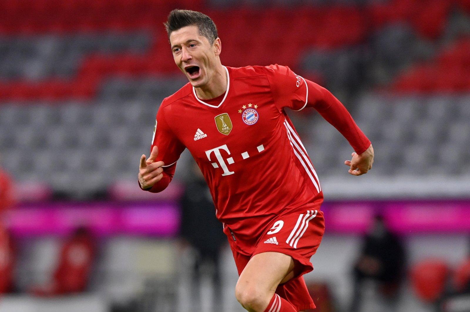 Bayern Munich forward Robert Lewandowski celebrates after scoring a goal against Borussia Dortmund at the Allianz Arena, Munich, Germany, March06, 2021. (EPA Photo)