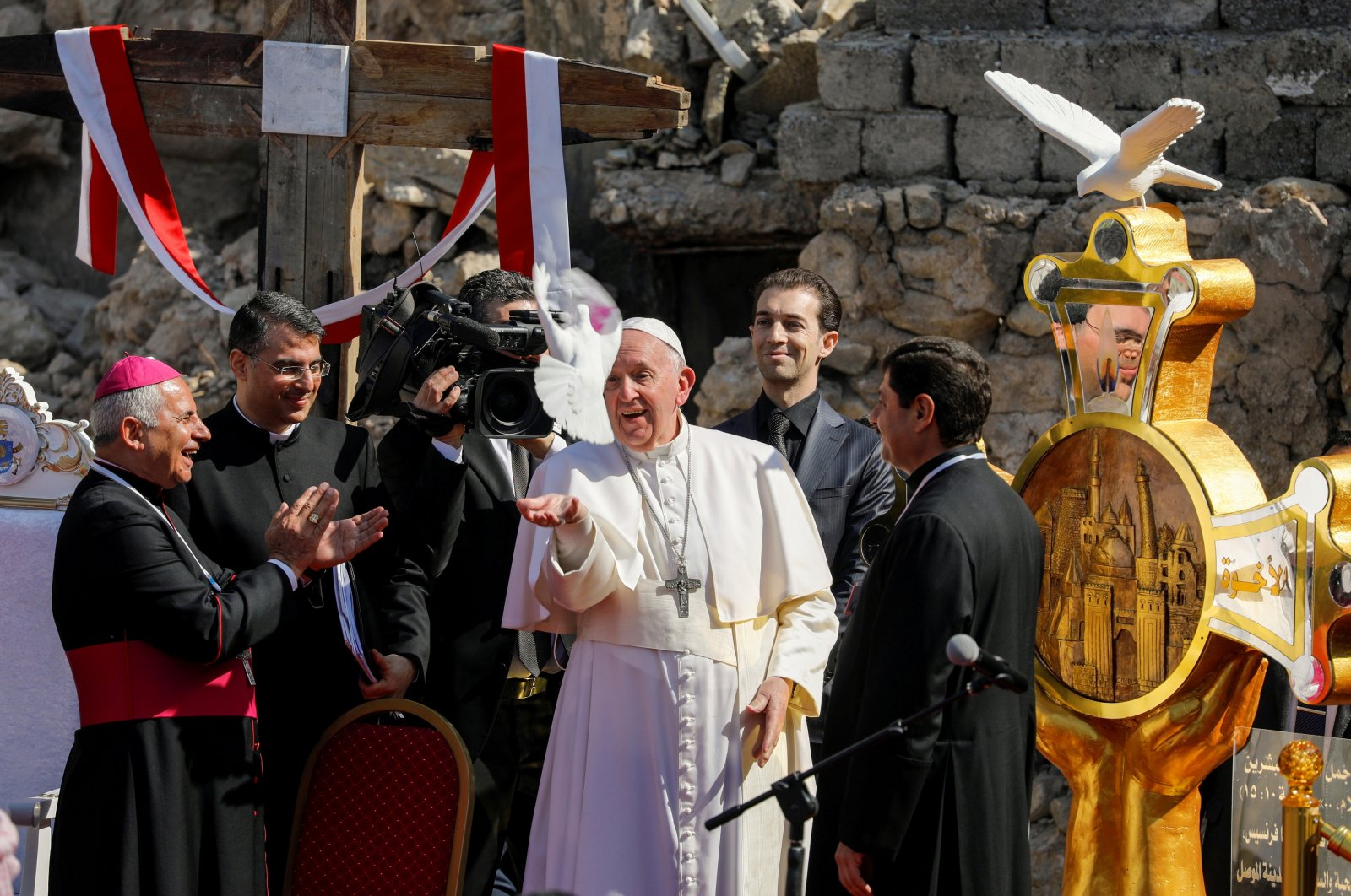 """Pope Francis releases a white dove during a prayer for war victims at """"Hosh al-Bieaa,"""" Church Square, in Mosul's Old City, Iraq, March 7, 2021. (Reuters Photo)"""