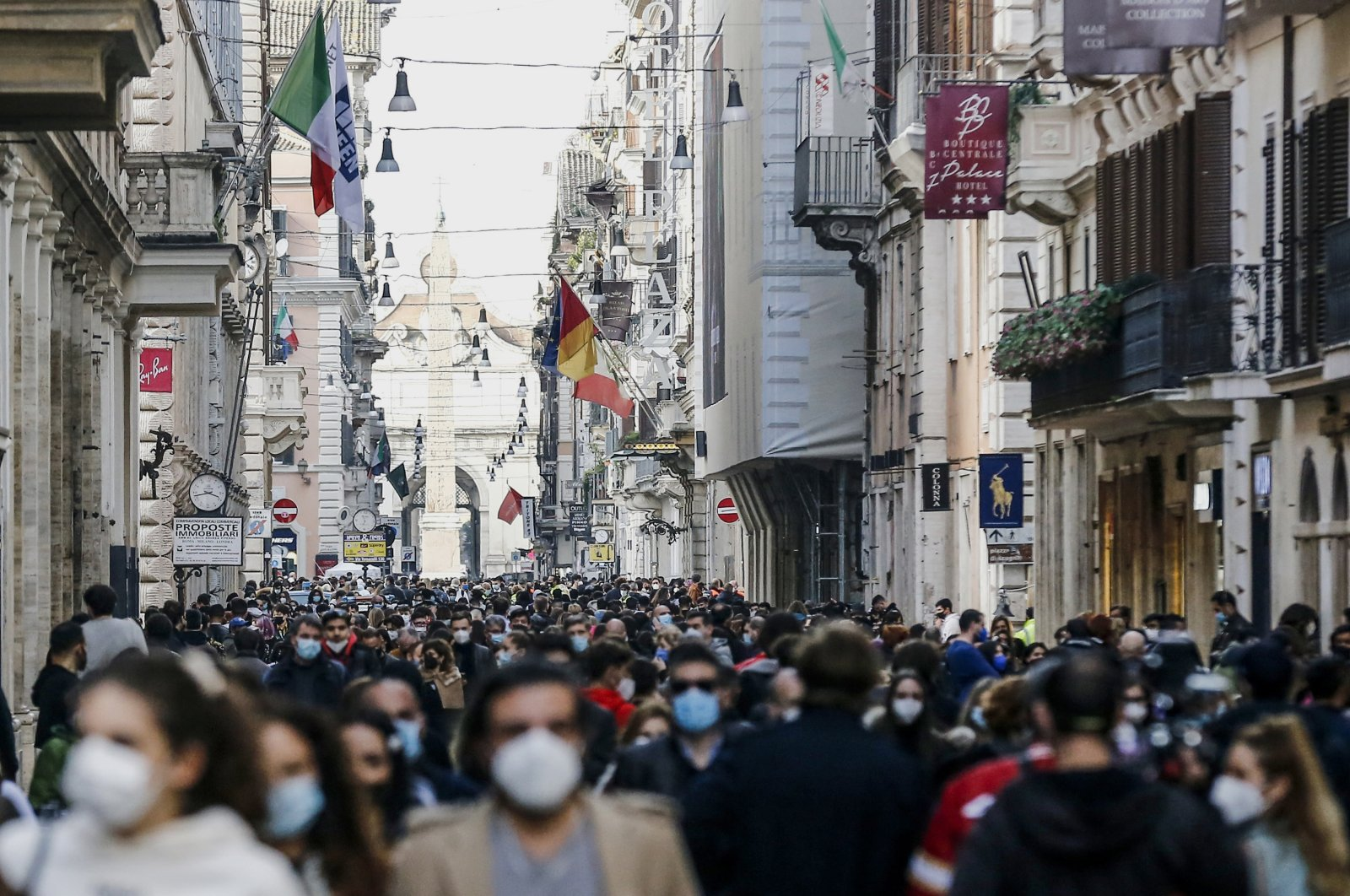 People crowd Via del Corso shopping street in Rome, following the ease of restriction measures to curb the spread of COVID-19, Feb. 7, 2021. (AP Photo)