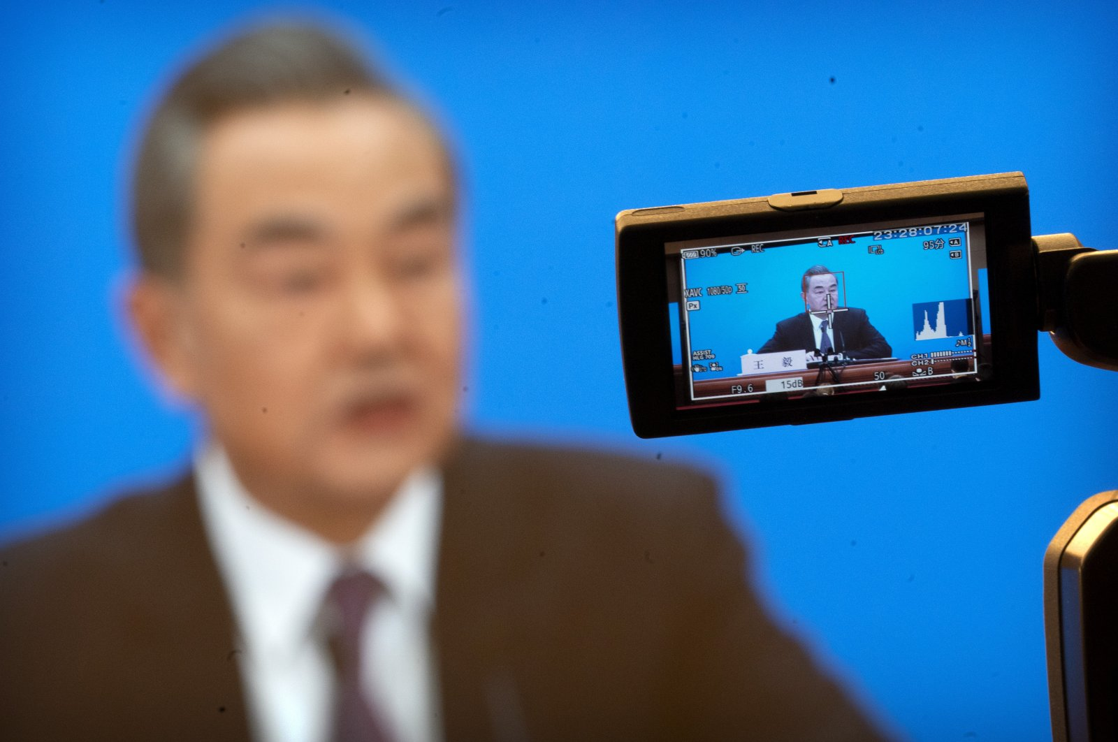 Chinese Foreign Minister Wang Yi is captured on a video camera's screen as he speaks during a remote video press conference held on the sidelines of the annual meeting of China's National People's Congress (NPC) in Beijing, March 7, 2021. (AP Photo)