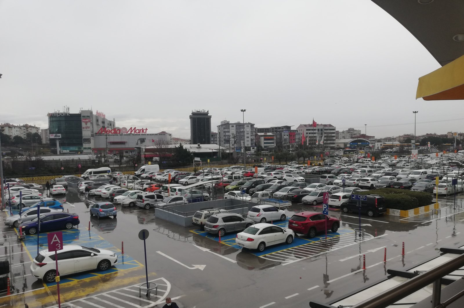 A shopping mall's parking lot is seen under rainfall in Northwestern Bursa province on March 6, 2021. (IHA Photo)