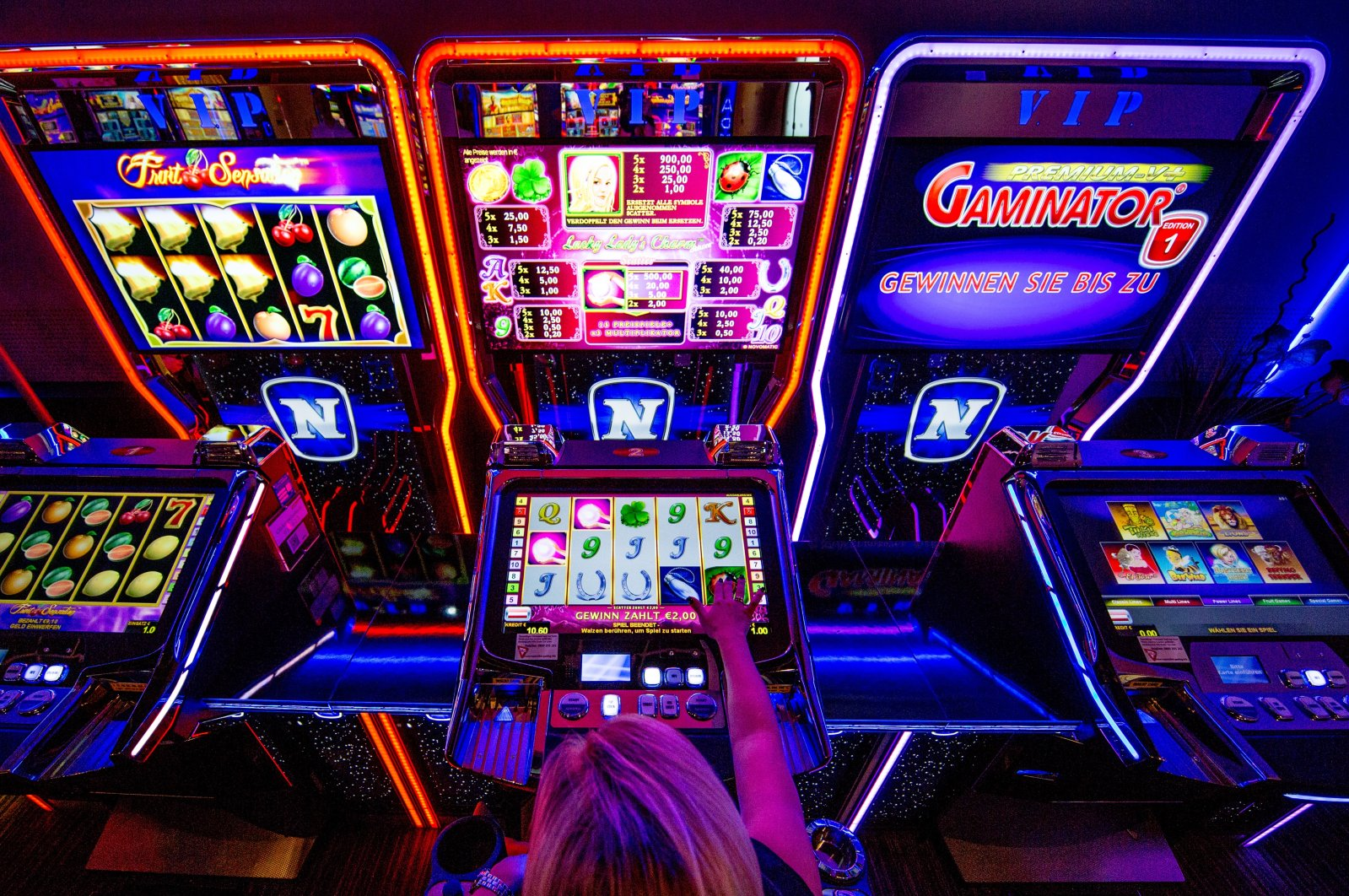 A customer plays on an electronic slot gambling machine inside a casino, in Wiener Neudorf, Austria, Aug. 17, 2017. (Photo by Getty Images)