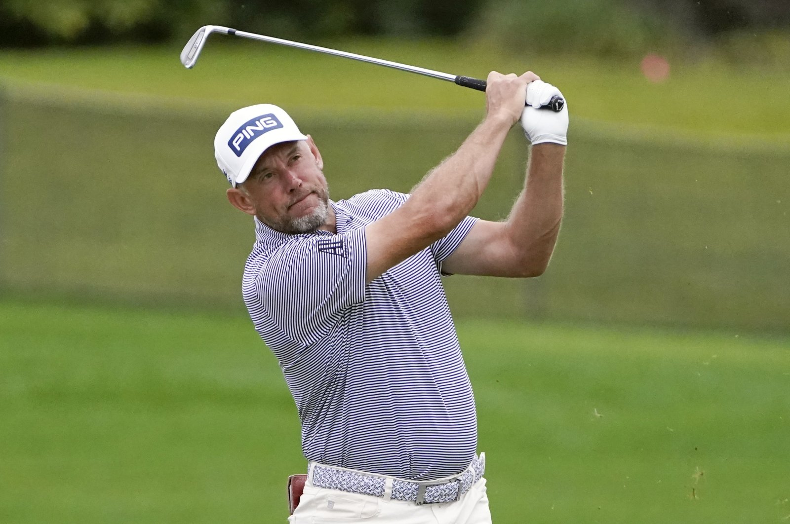 England's Lee Westwood hits a shot from the 16th fairway during the third round of the Arnold Palmer Invitational golf tournament in Orlando, Florida, March 6, 2021. (AP Photo)