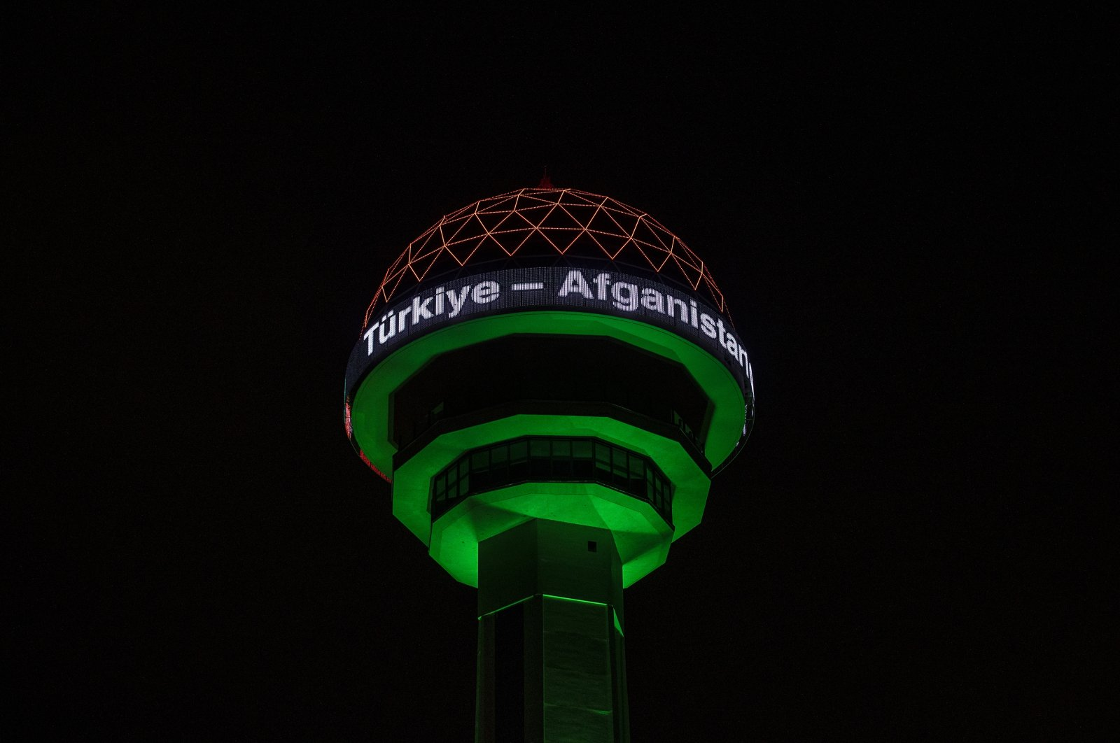 Ankara's landmark Atakule is illuminated by the colors of the Afghanistan flag to mark the 100th anniversary of diplomatic relations between the two countries. (AA Photo)