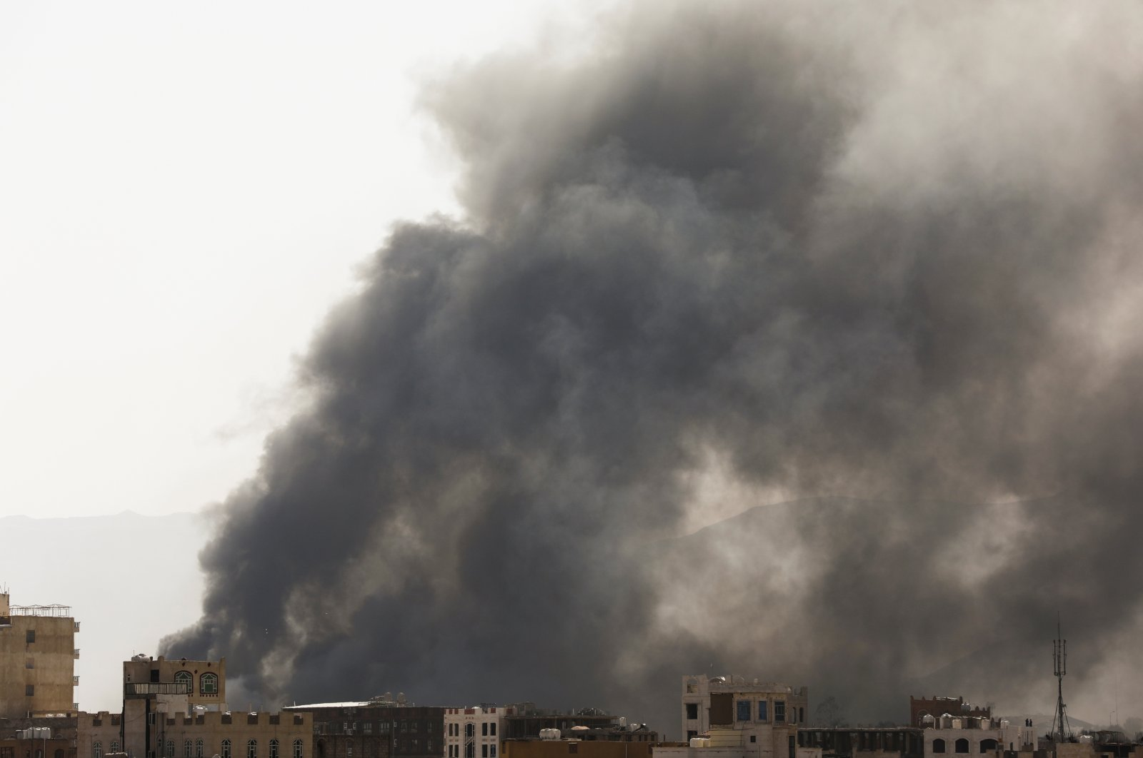 Smoke billows from the site of Saudi-led air strikes in Sanaa, Yemen, March 7, 2021. (Reuters Photo)