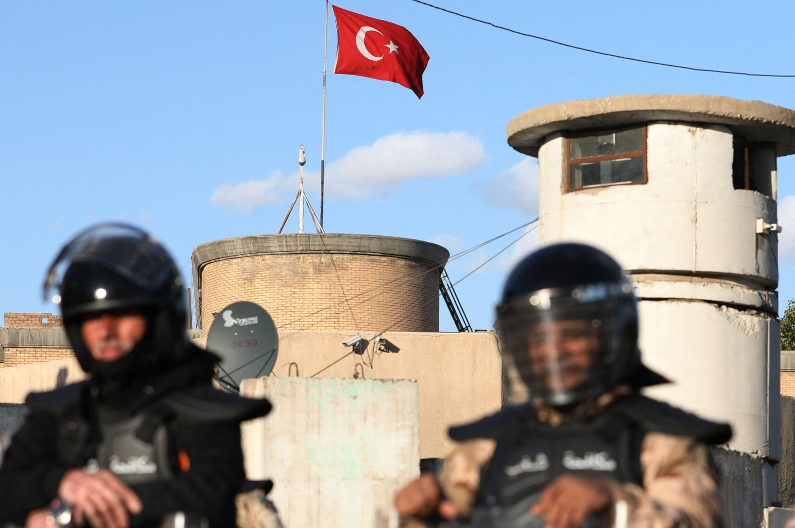 Iraqi riot police stand guard at the Turkish Embassy in Baghdad after the Iran-backed Asaib Ahl al-Haq paramilitary group recently said if Turkey expanded its military operations into the strategic northwestern enclave of Sinjar, it would fight back, Feb. 18, 2021. (AFP Photo)