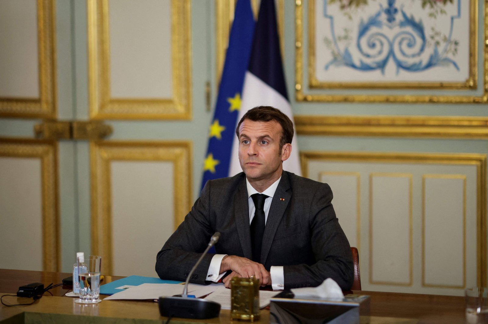 French President Emmanuel Macron reacts as he takes part in the Act-A videoconference meeting with the African Union board at the Elysee Palace, in Paris, on March 3, 2021. (AFP Photo)