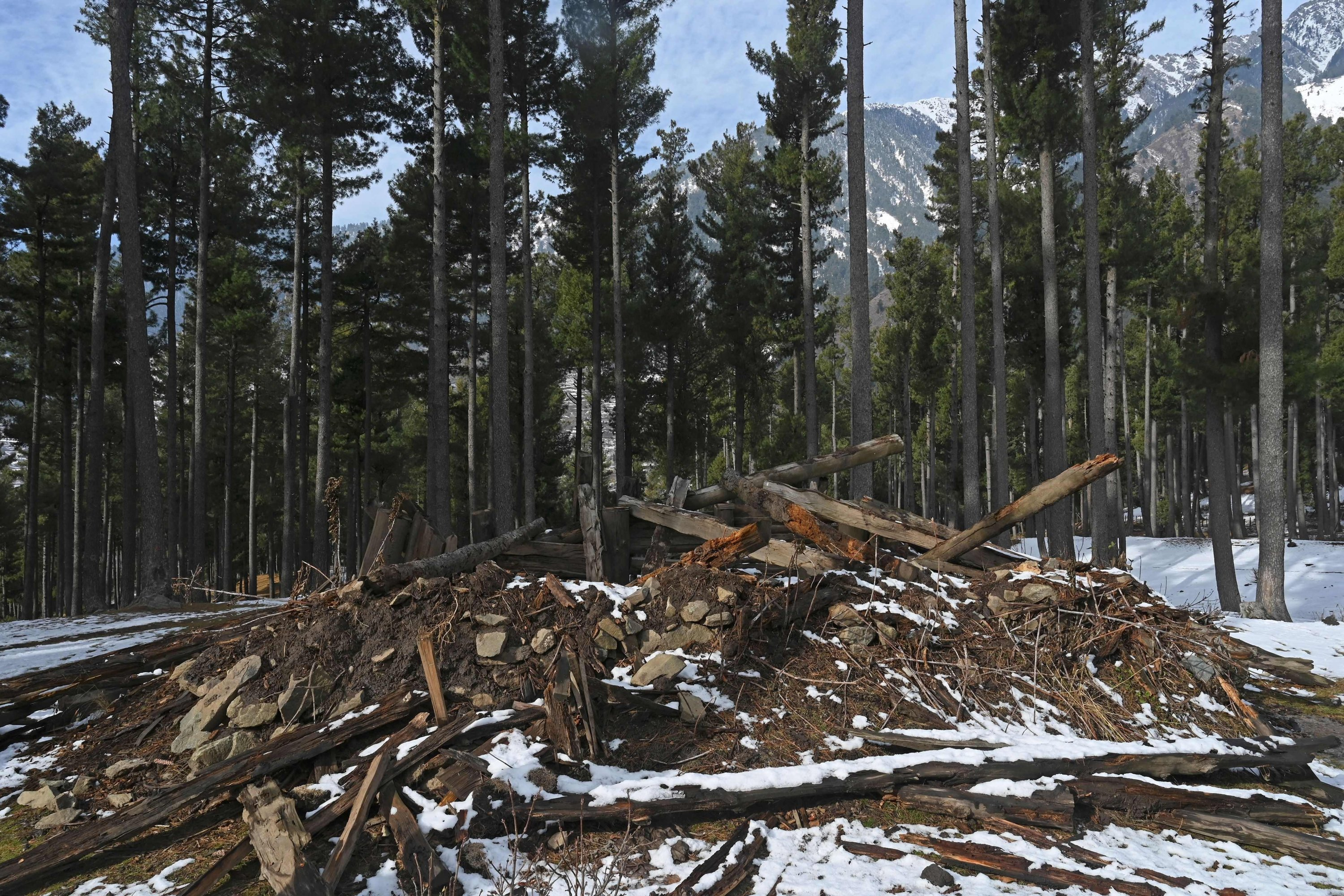 A log house dismantled by forest officials after it was claimed to have been built illegally on encroached forest land is pictured at Lidroo village, Pahalgam in the Anantnag district of Jammu and Kashmir, Dec. 14, 2020. (AFP Photo)