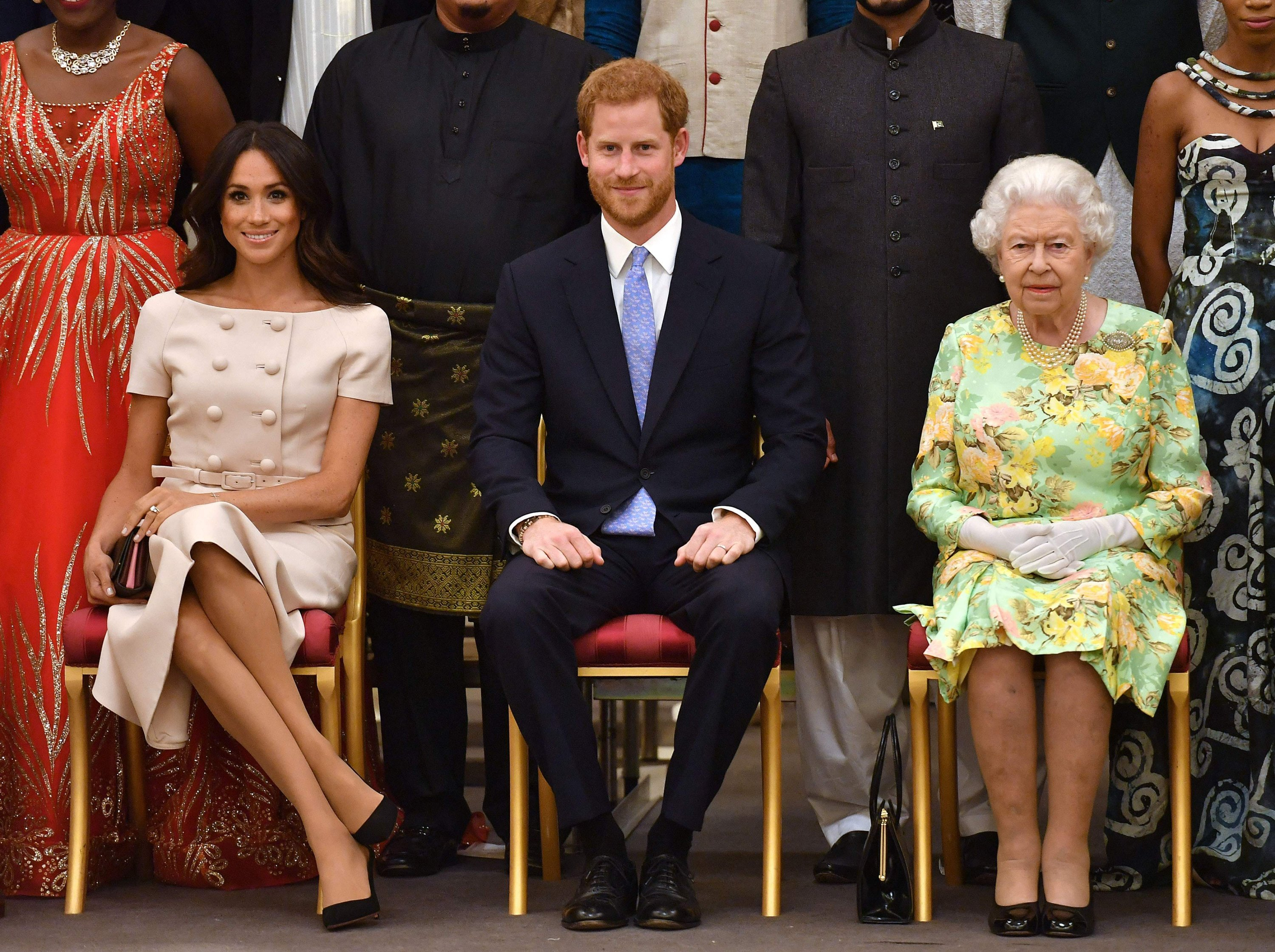 Meghan, Duchess of Sussex (Left), Britain's Prince Harry, Duke of Sussex (Center) and Britain's Queen Elizabeth II pose for a picture during the Queen's Young Leaders Awards Ceremony at Buckingham Palace in London, U.K., June 26, 2018. (AFP Photo)