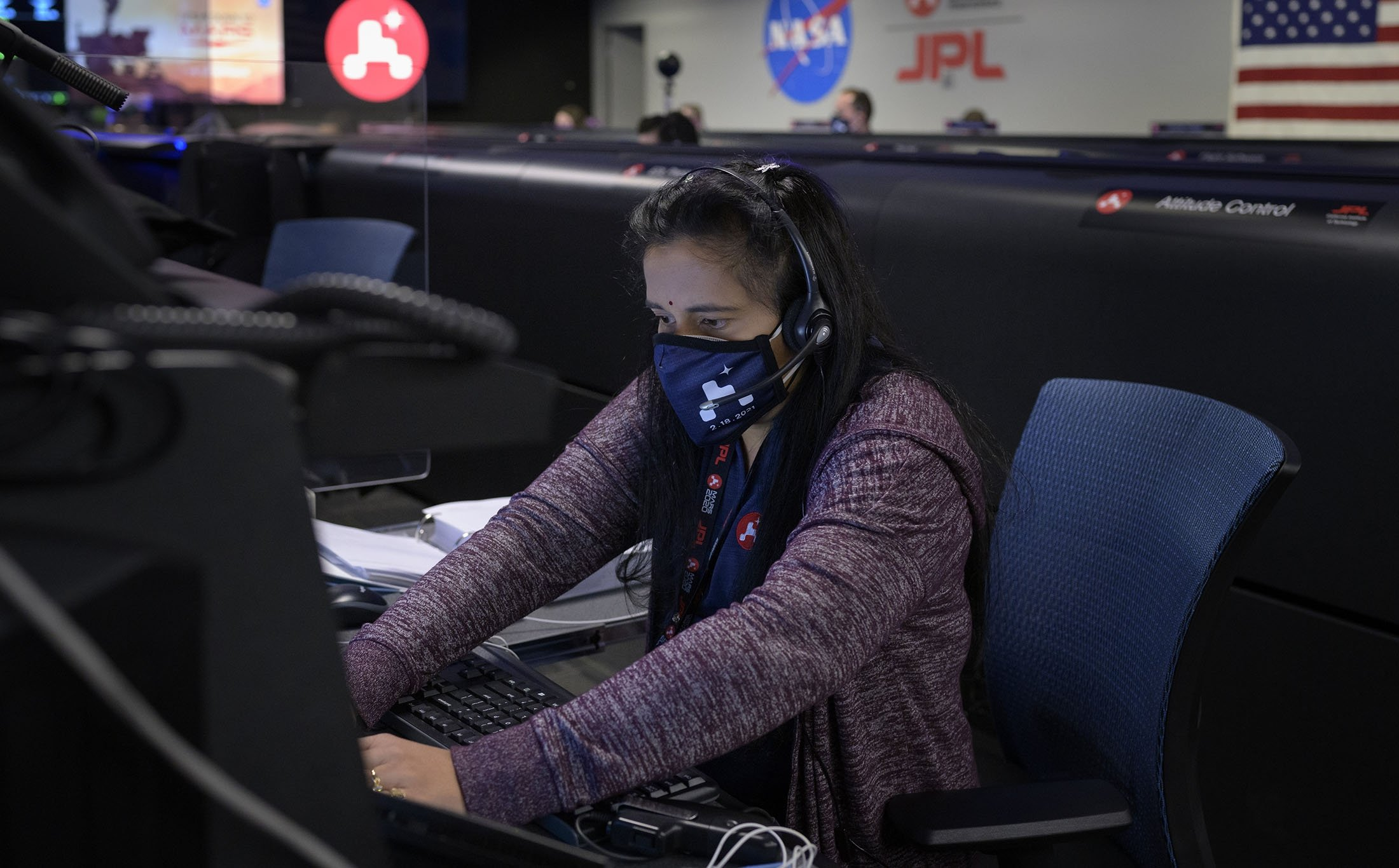 In this handout image provided by NASA, Perseverance Mars rover mission commentator and guidance, navigation, and controls operations Lead Swati Mohan studies data on monitors in mission control, February 18, 2021 at NASA's Jet Propulsion Laboratory in Pasadena, California. (NASA via Getty Images)